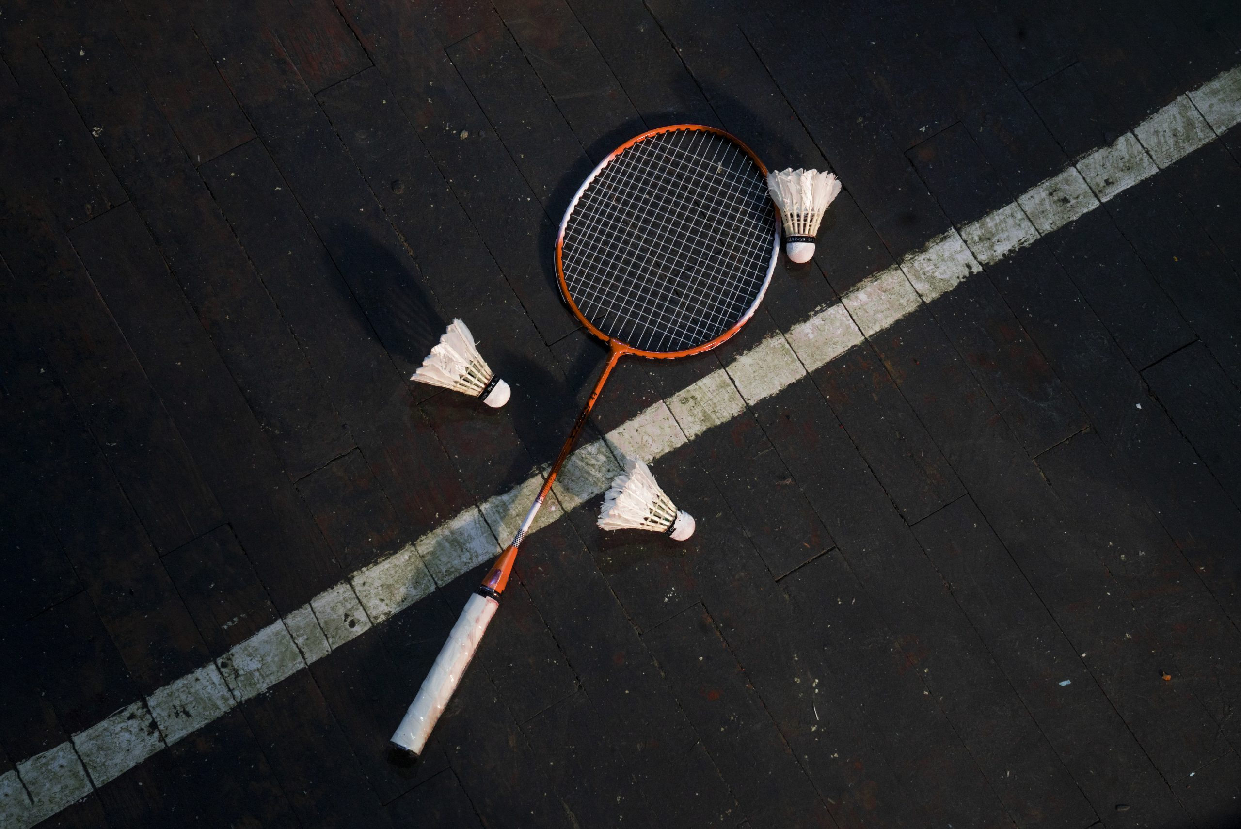 Badminton equipment on the ground