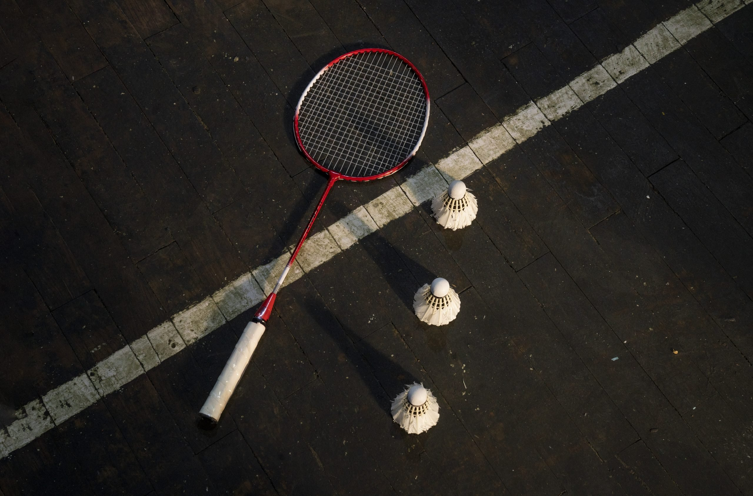 Badminton racket and shuttlecock on the ground