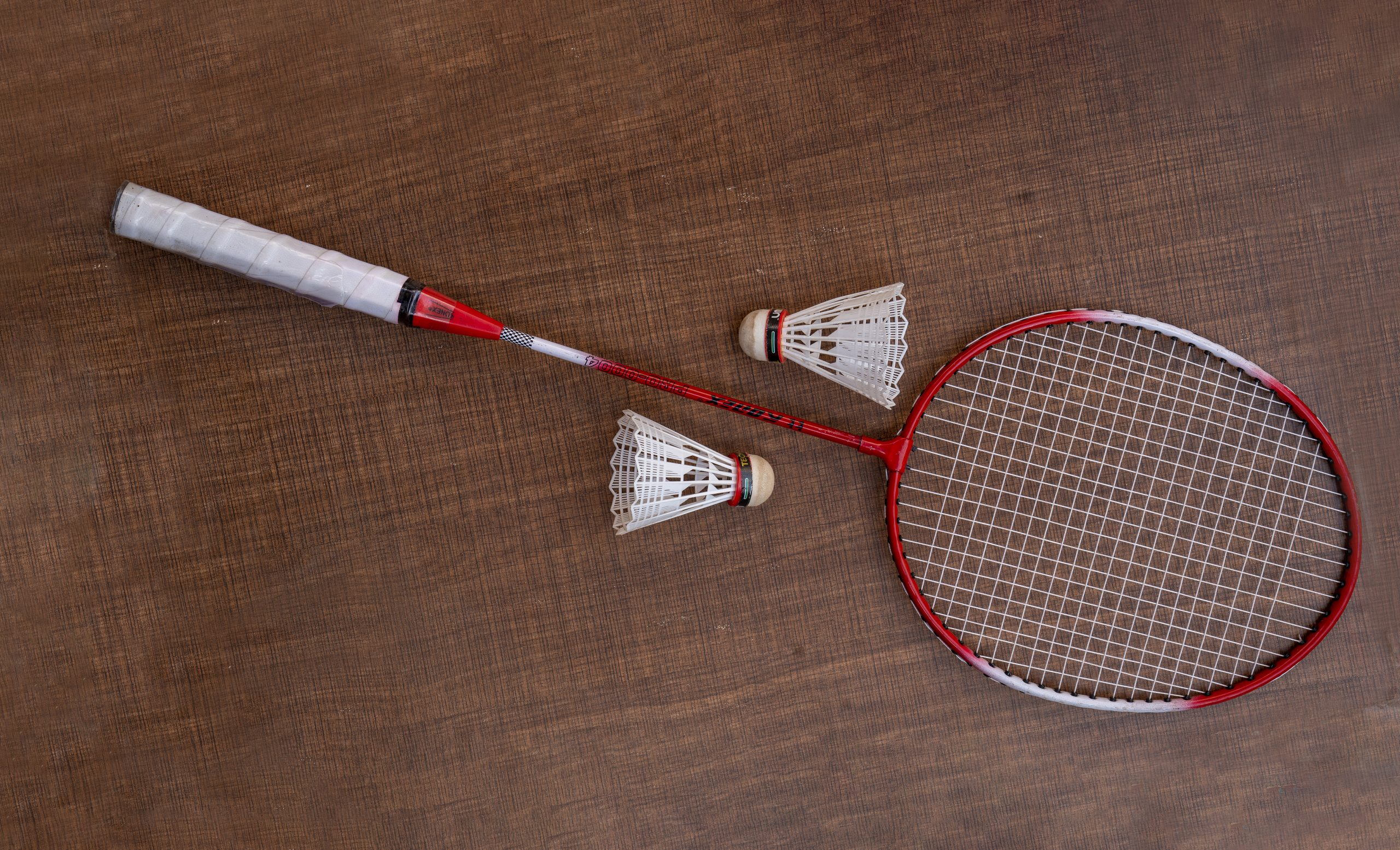 Badminton racket and two shuttlecocks