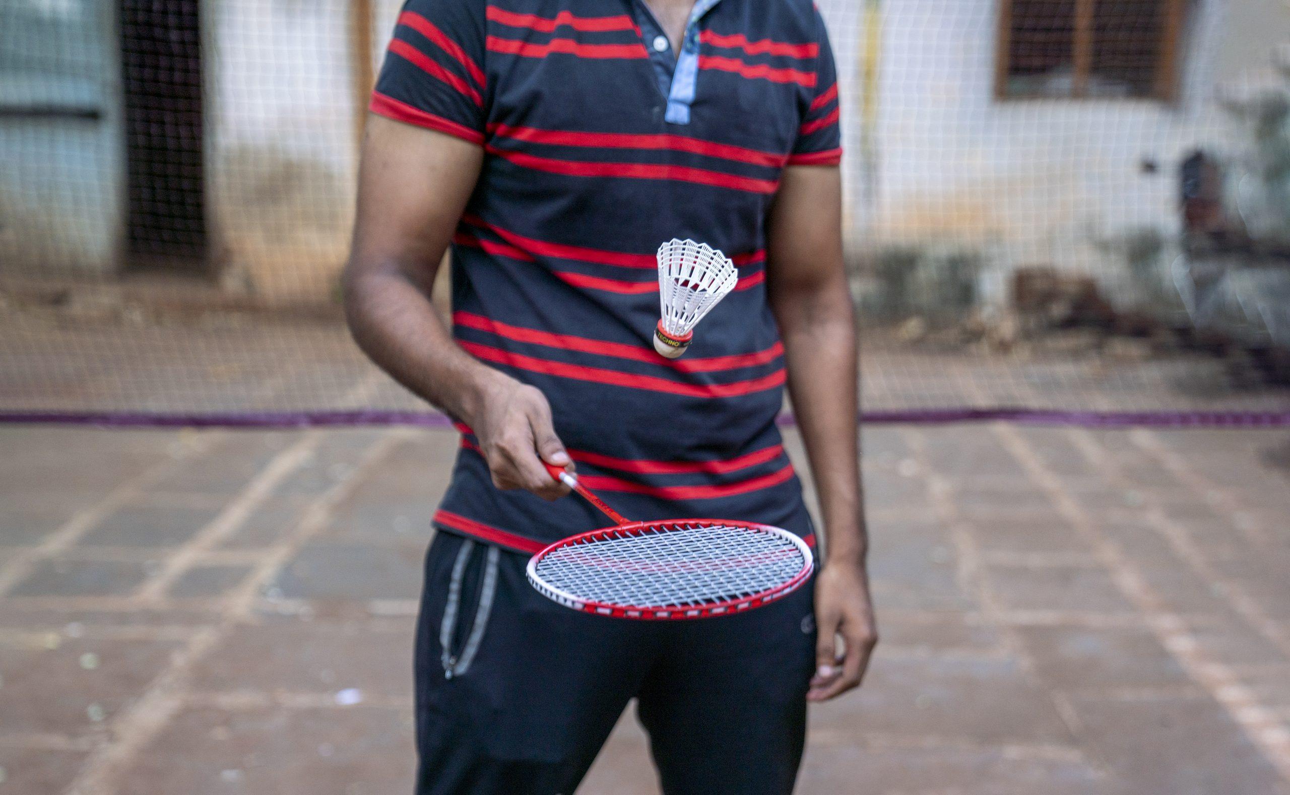 Man holding badminton racket
