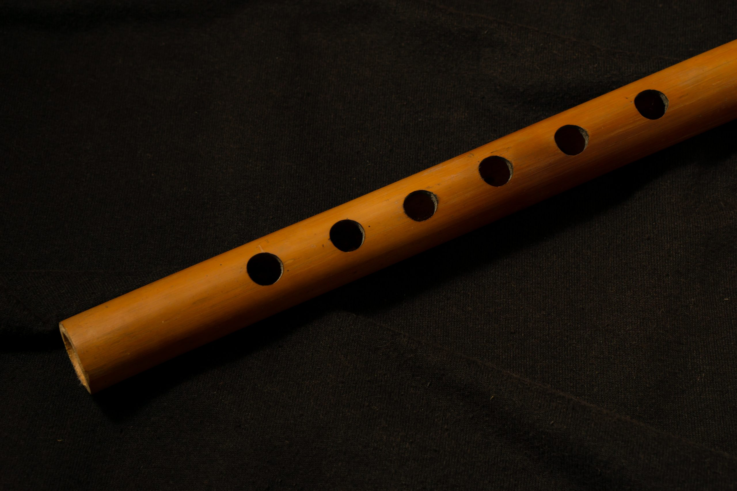 Bamboo flute on a black background