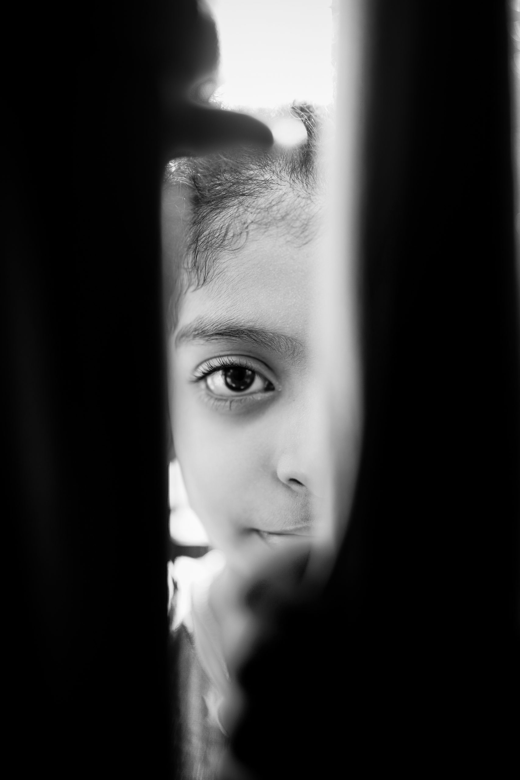Black and white portrait of a child half face