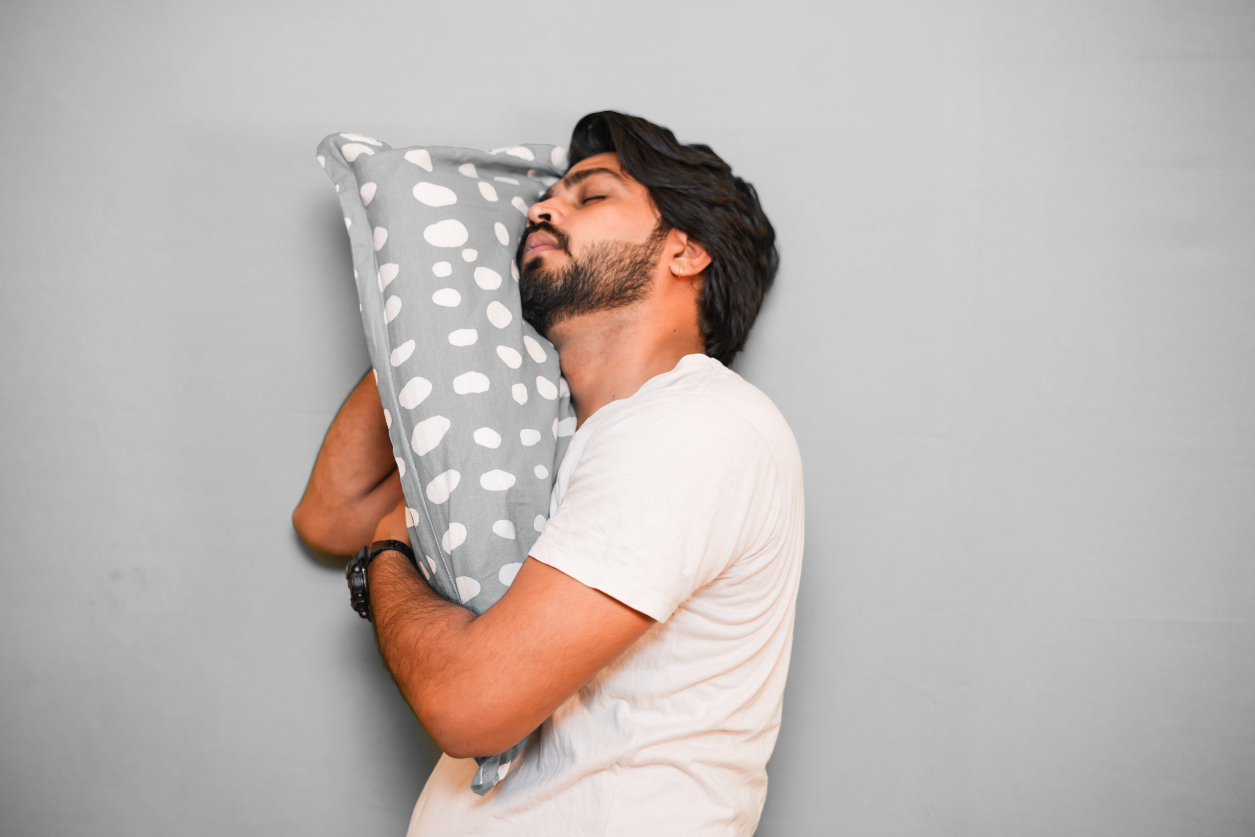 Boy leaning in grey pillow