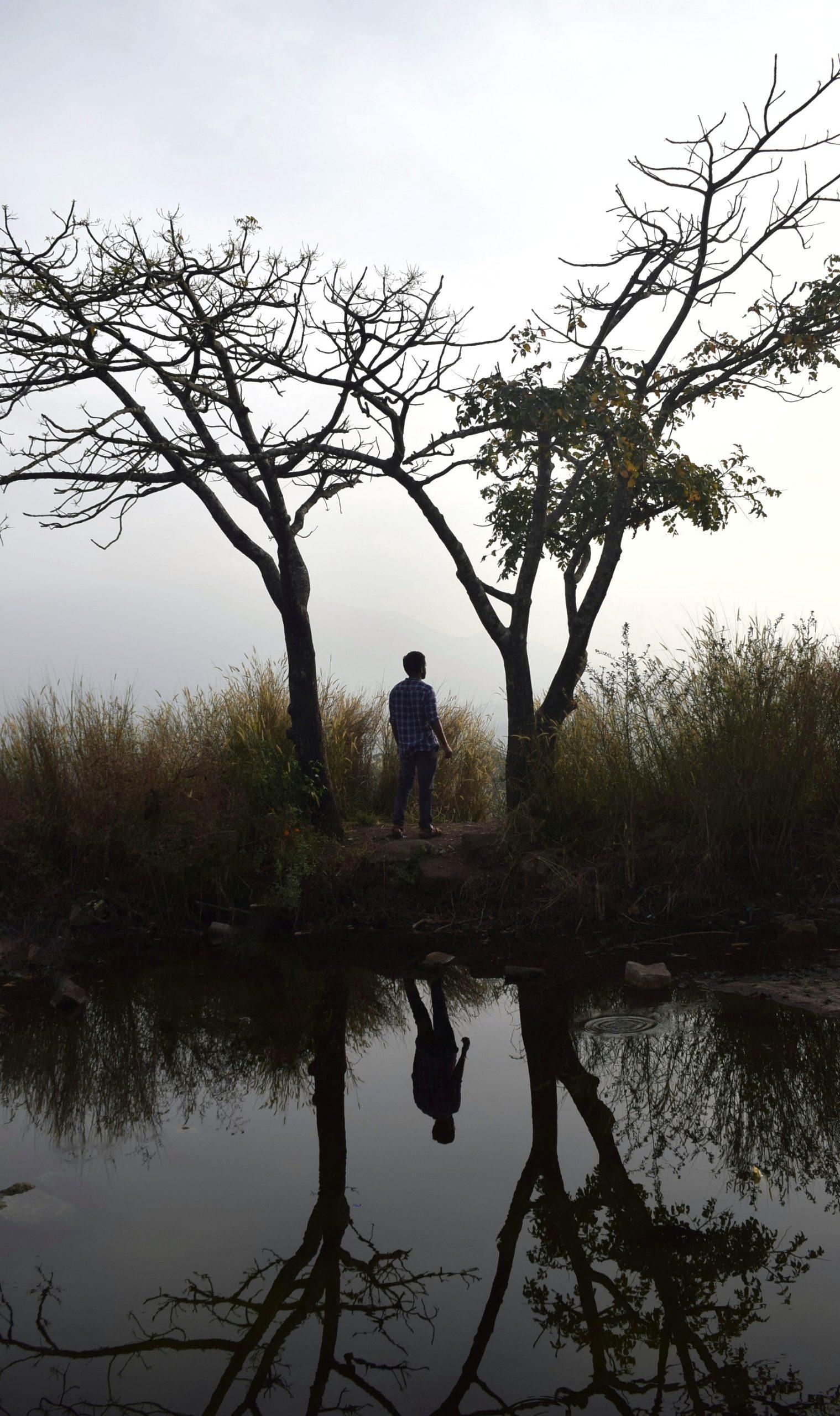 A boy standing on hilltop