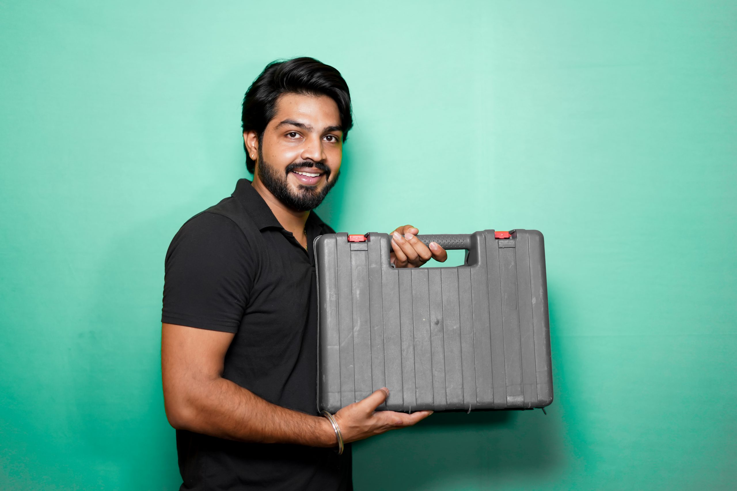 Man holding a toolbox