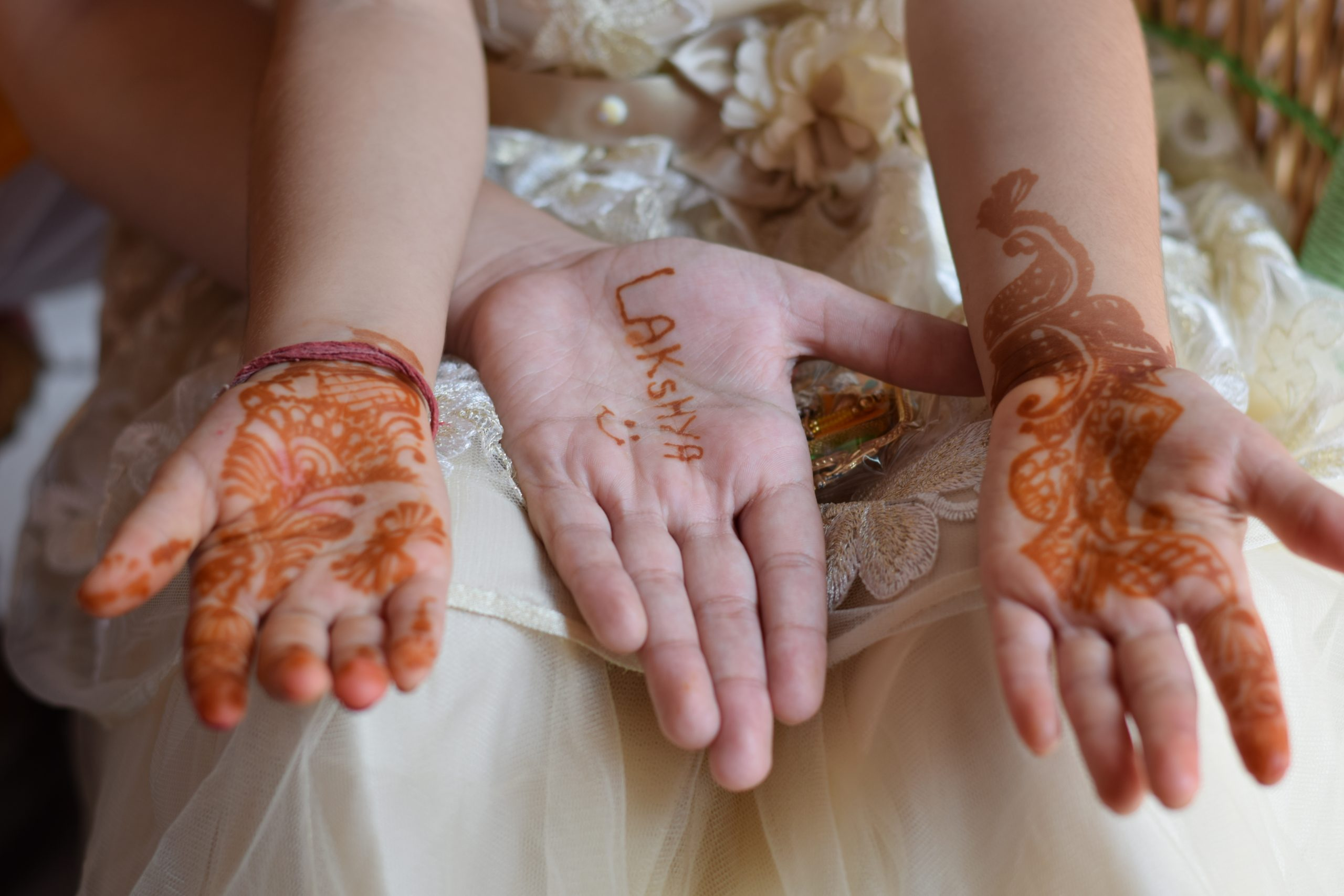 Brother and sister with Mehndi art on hands