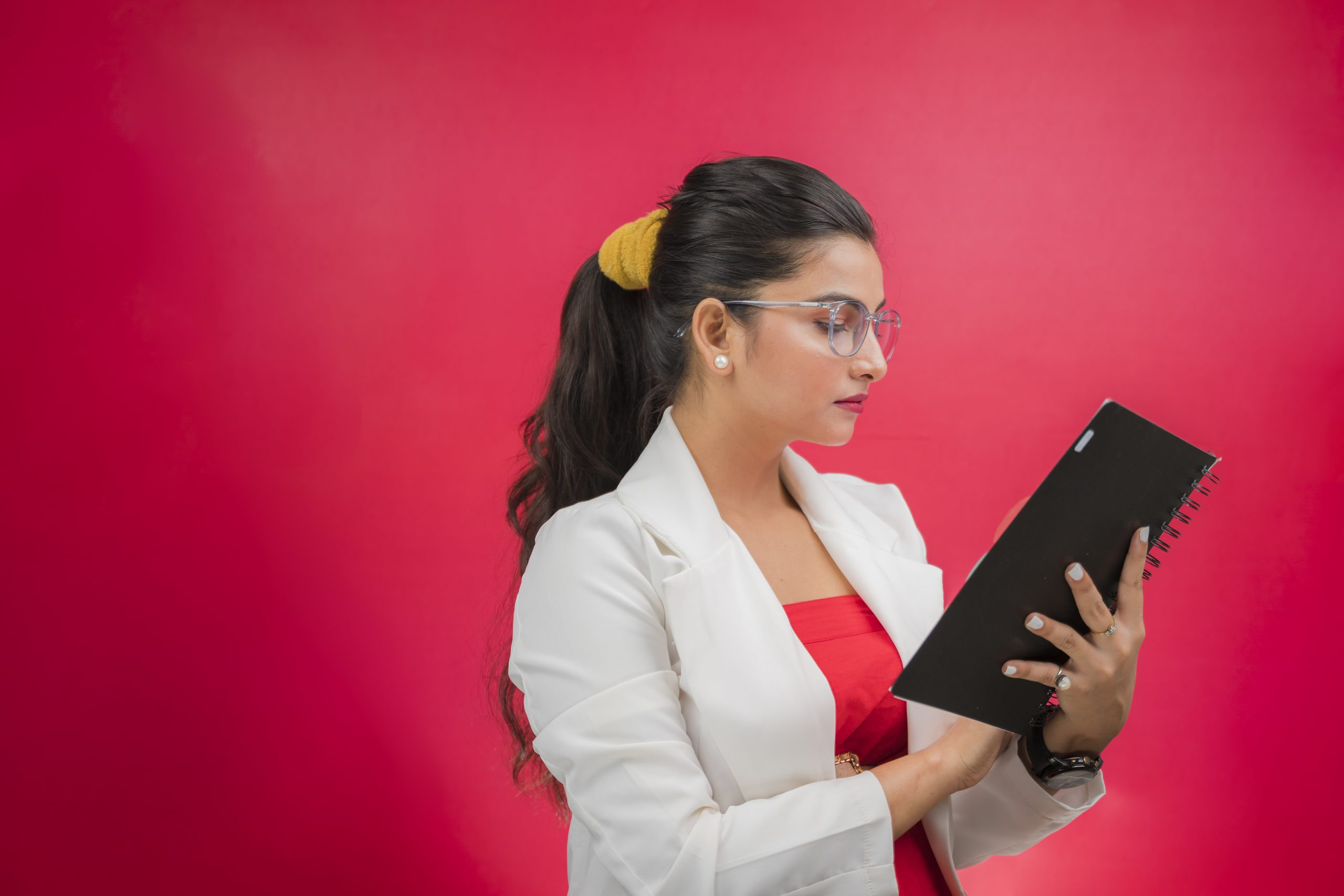Business woman reading notebook