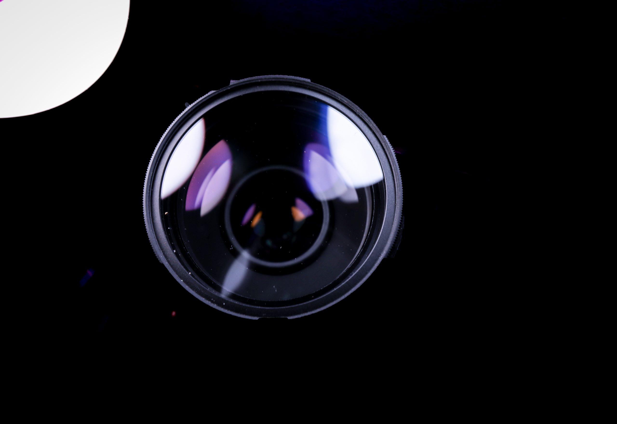 Camera lens on black background