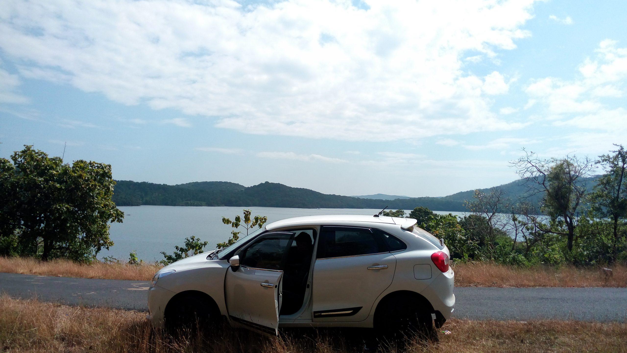Car with an open door under the blue sky