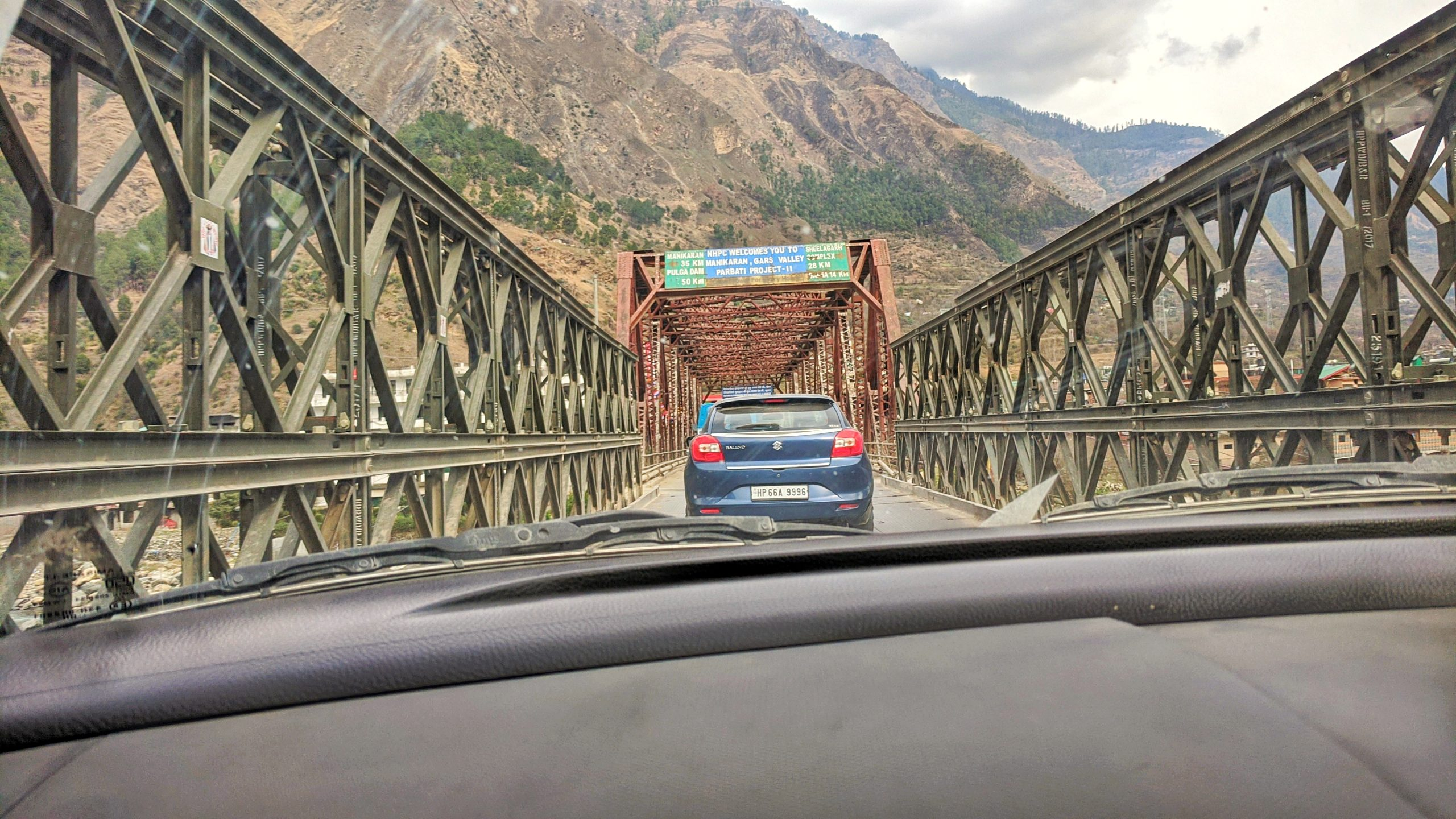 Cars moving on a narrow bridge