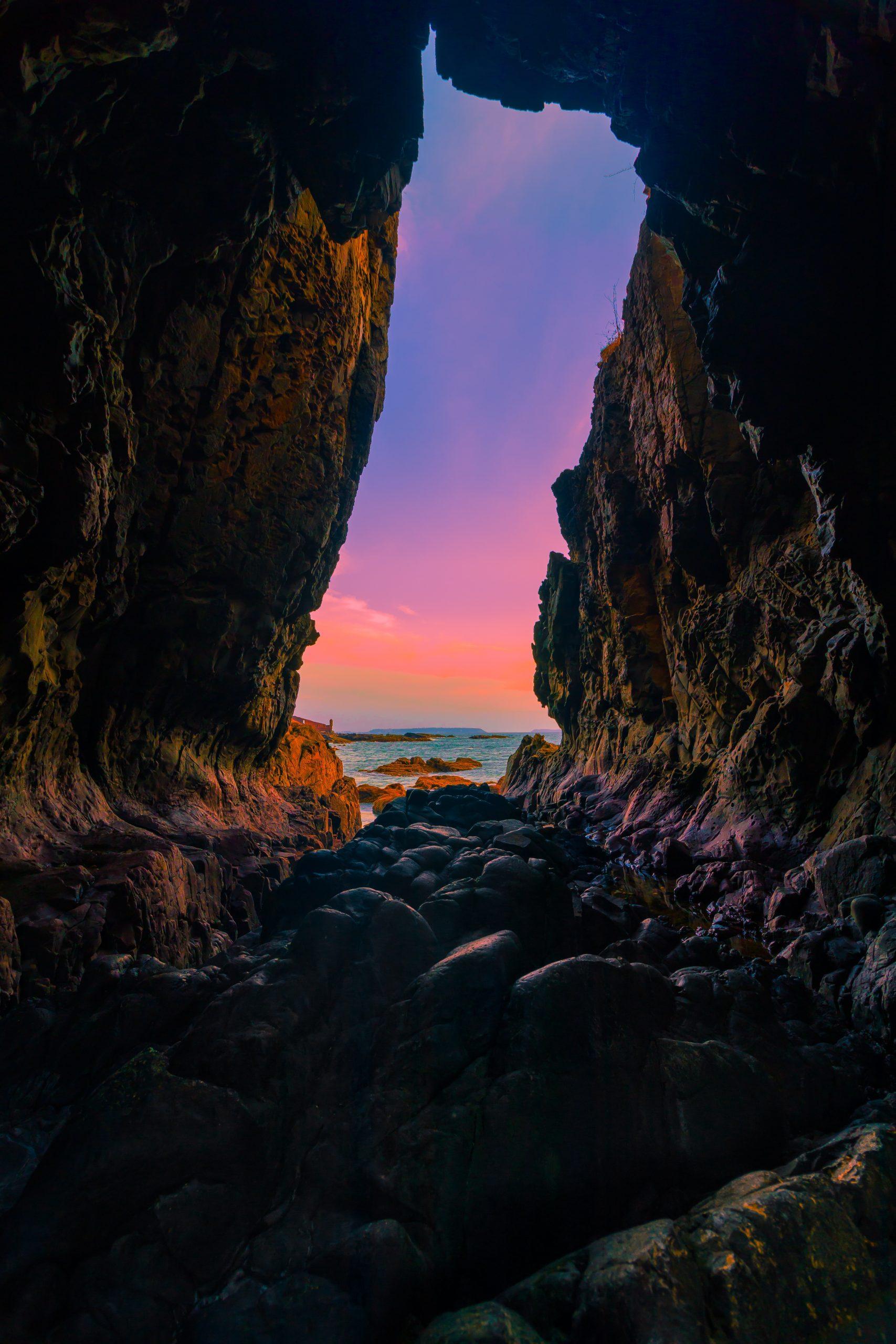 entry to a beach through a cave
