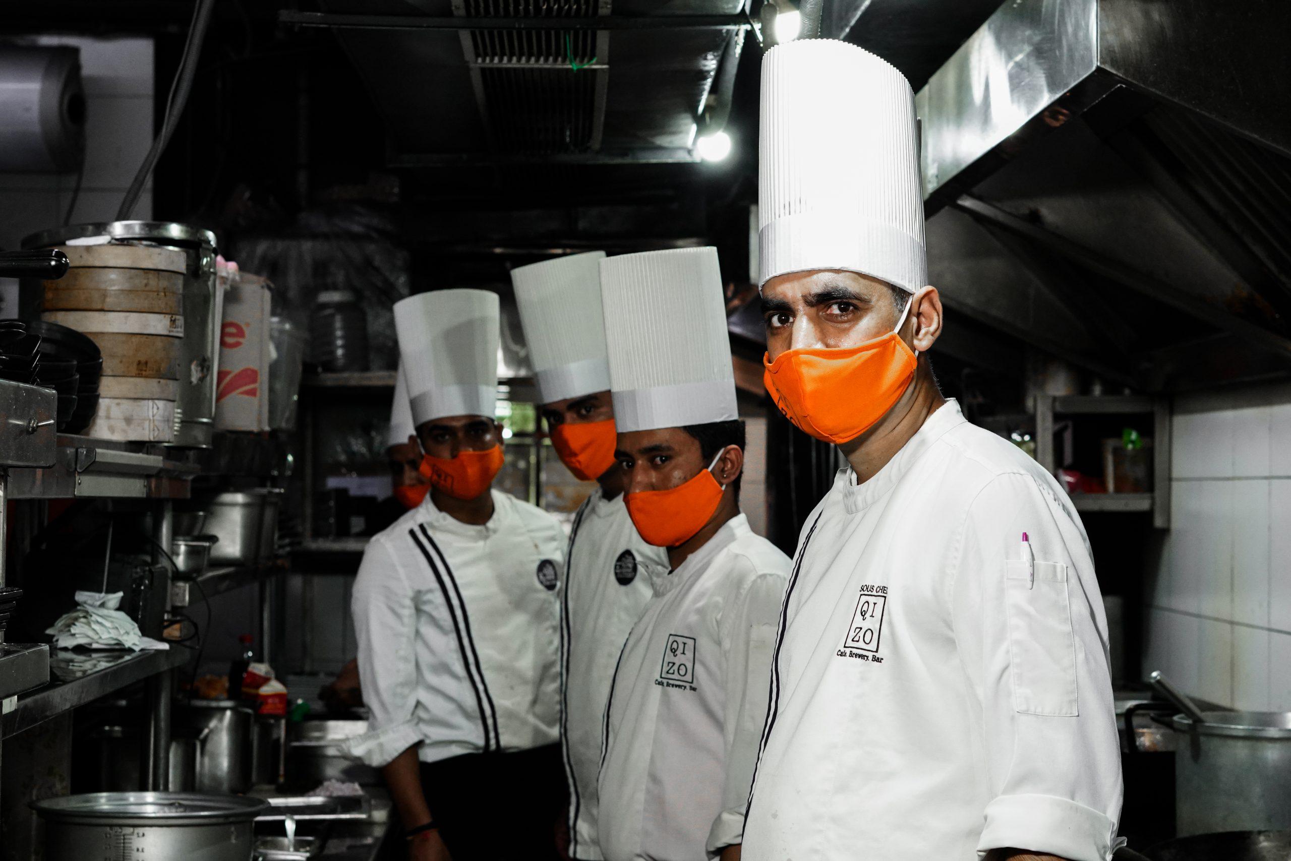 Chefs in the Kitchen wearing Masks