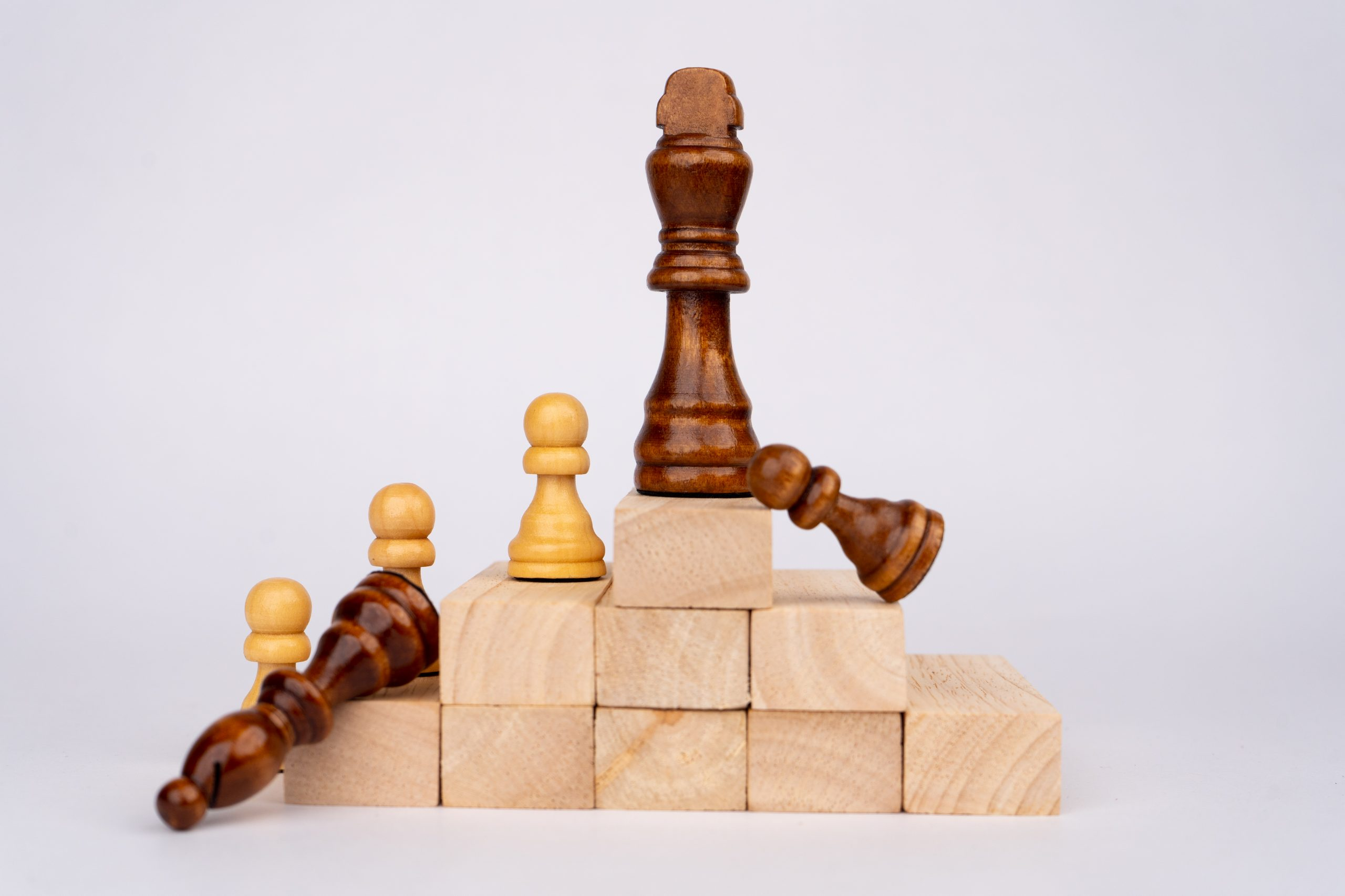Chess pieces formation on wooden blocks