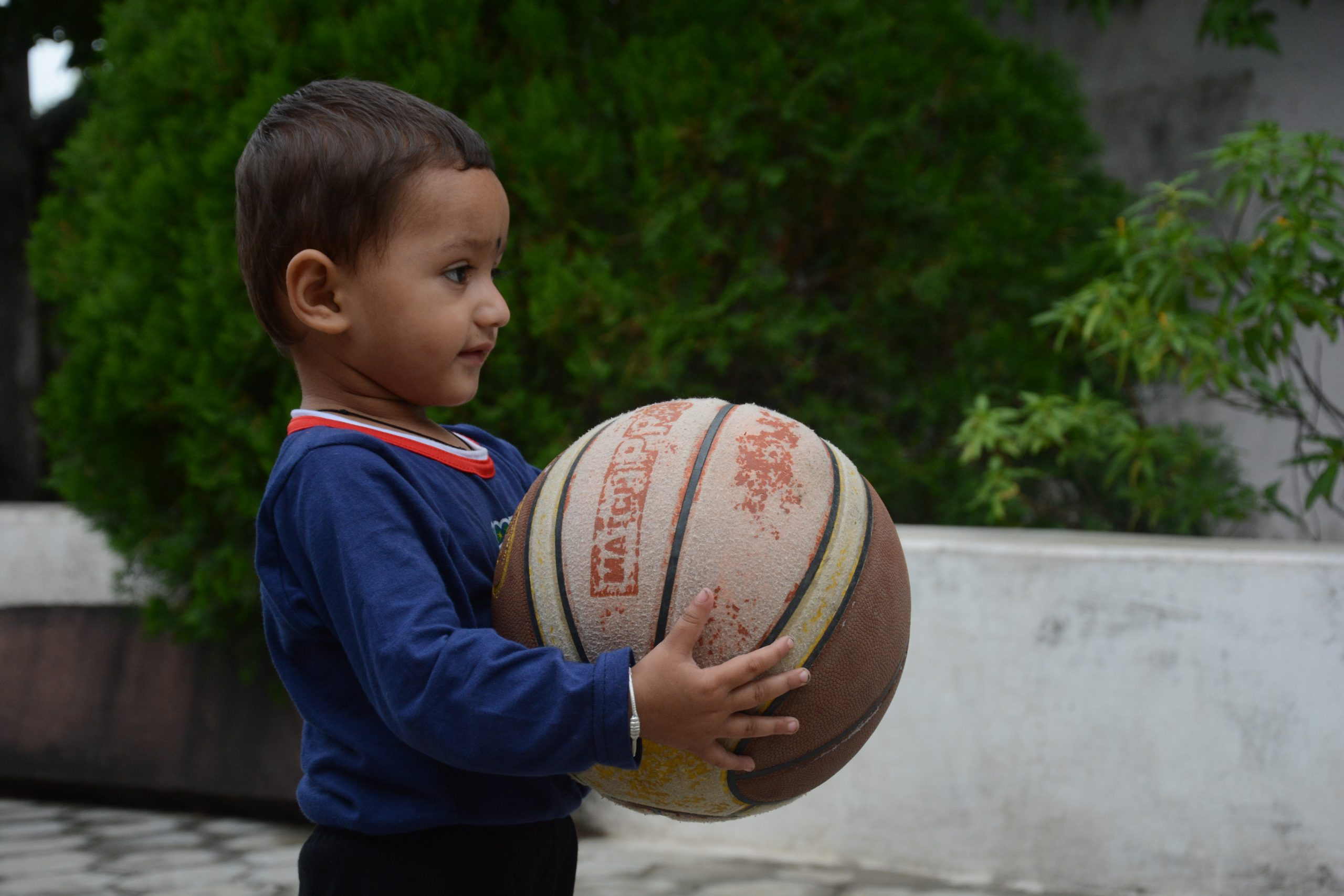 Child Holding a Ball