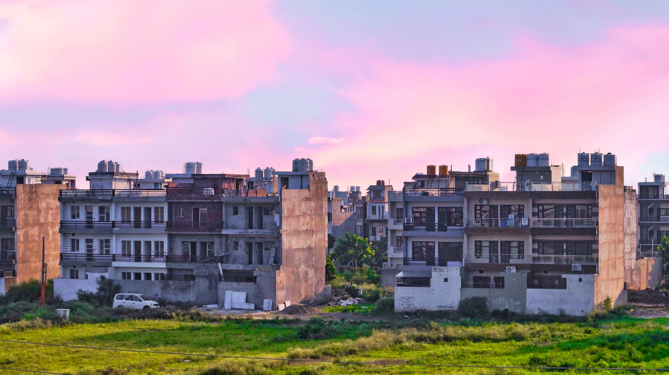Pink sky and housing apartments
