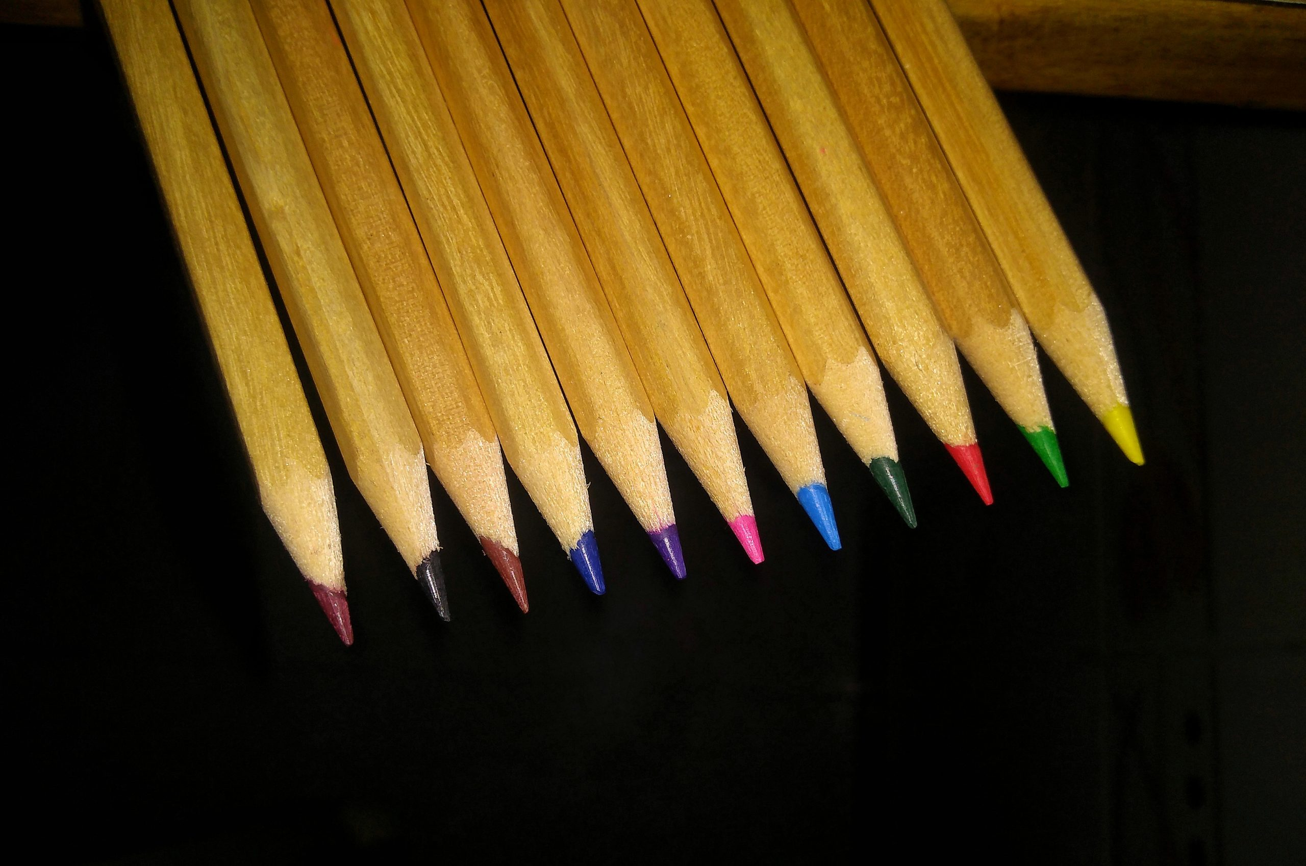Colored Pencils on Dark Background