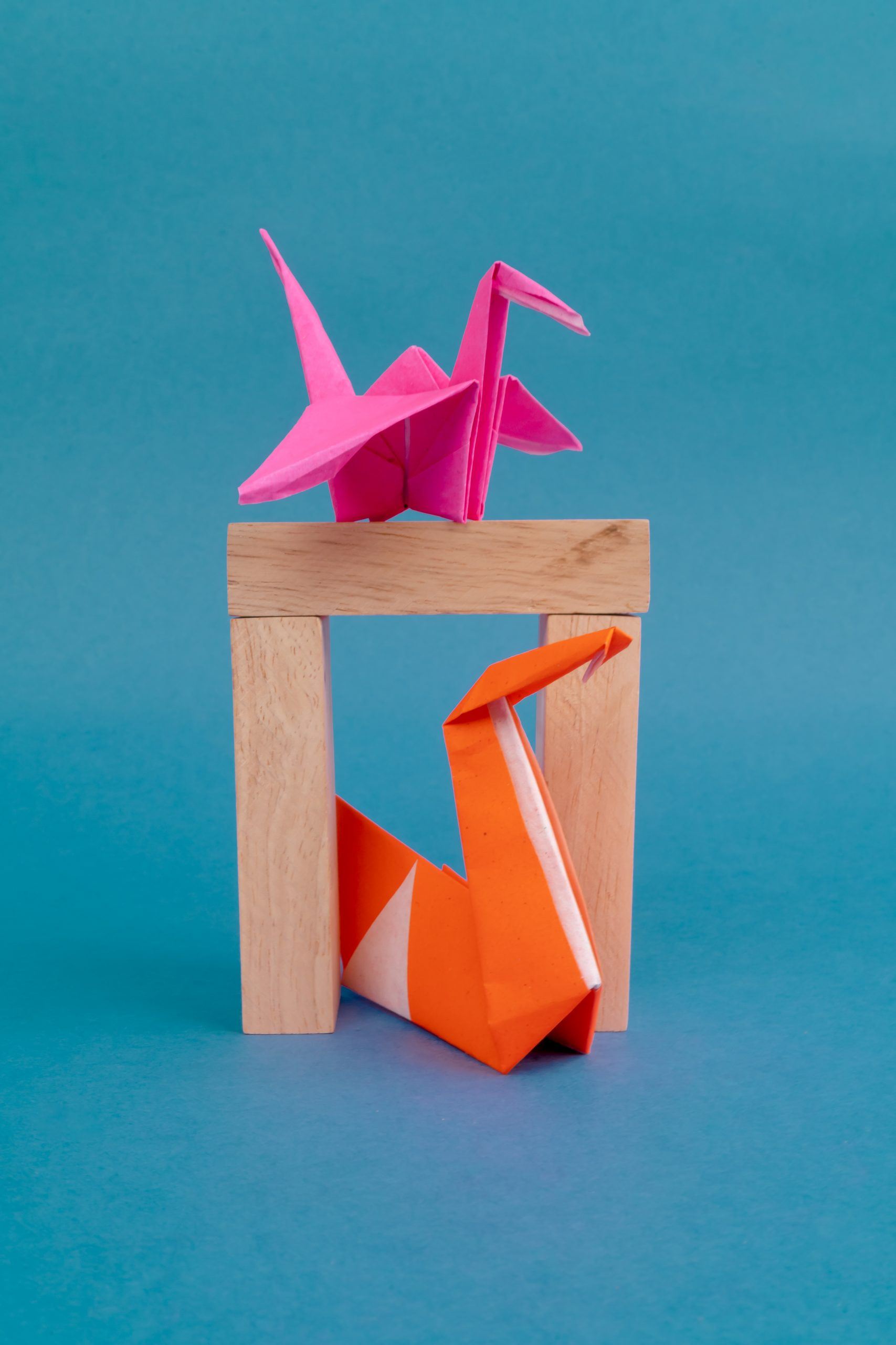 Crane and swan origami on wooden block