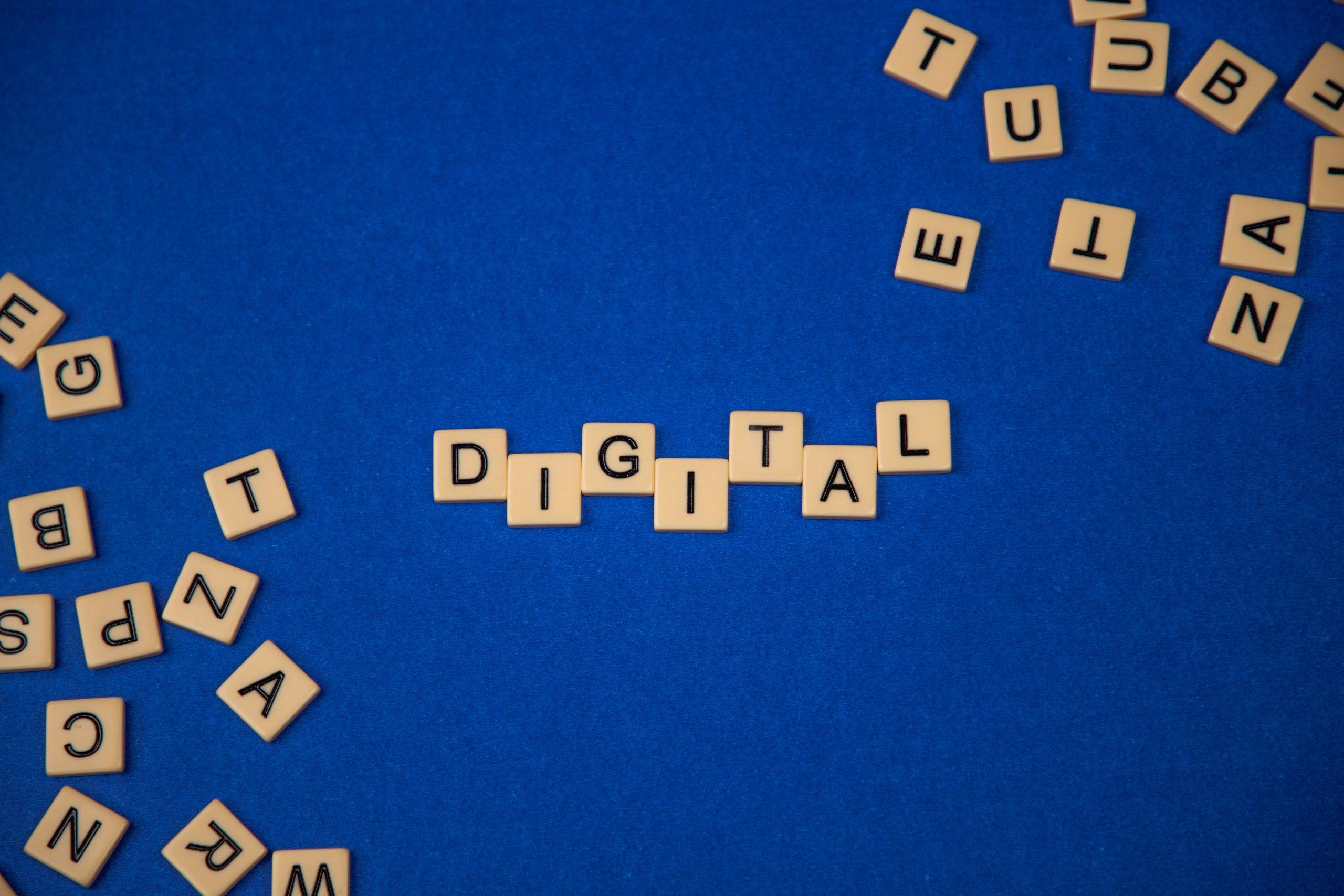 Digital written on scrabble