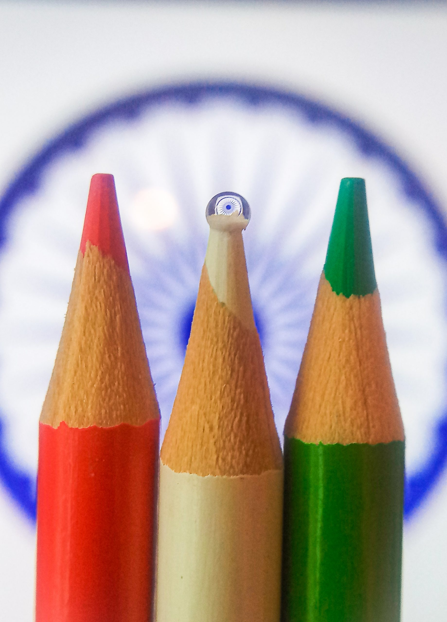 Ashok chakra behind color pencils