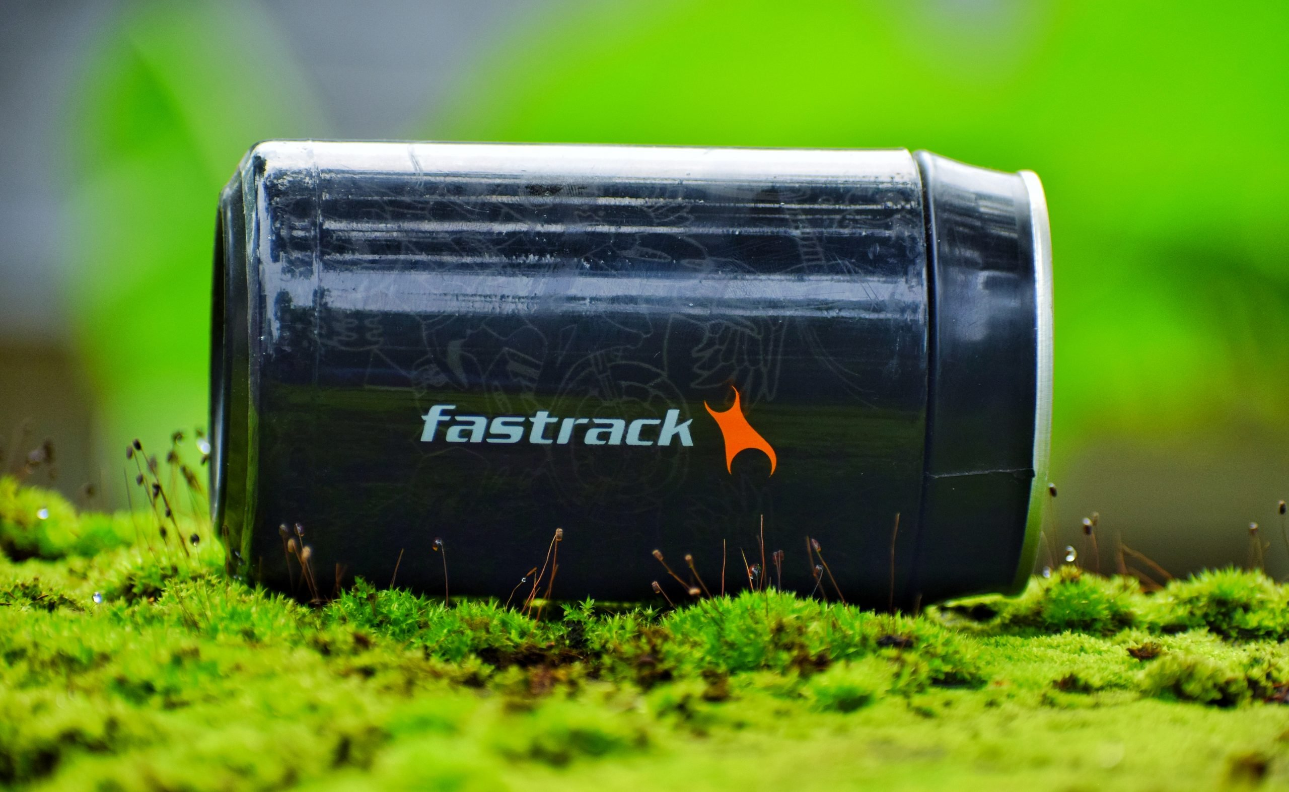 Drink can on a mossy ground