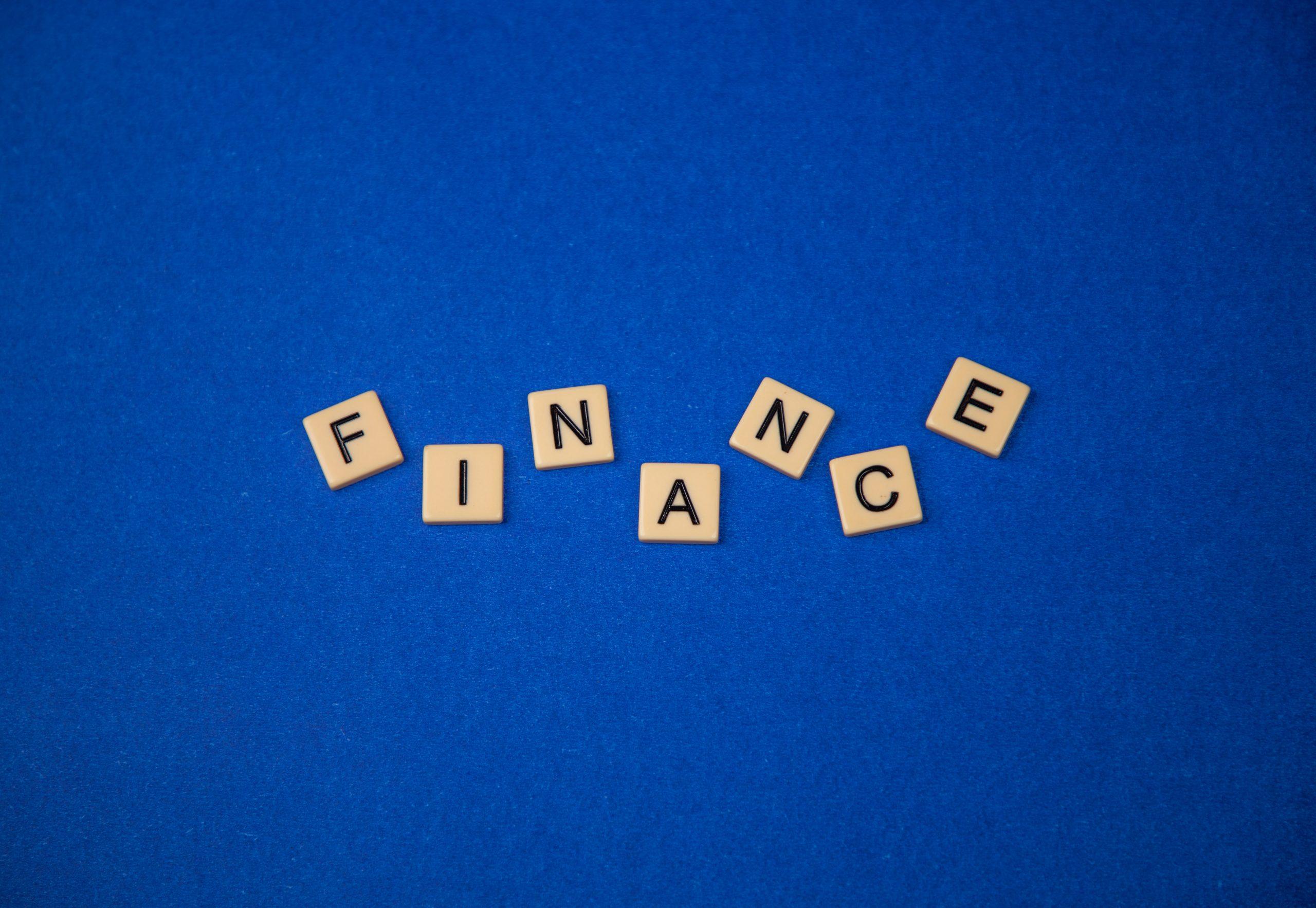 Finance written on scrabble