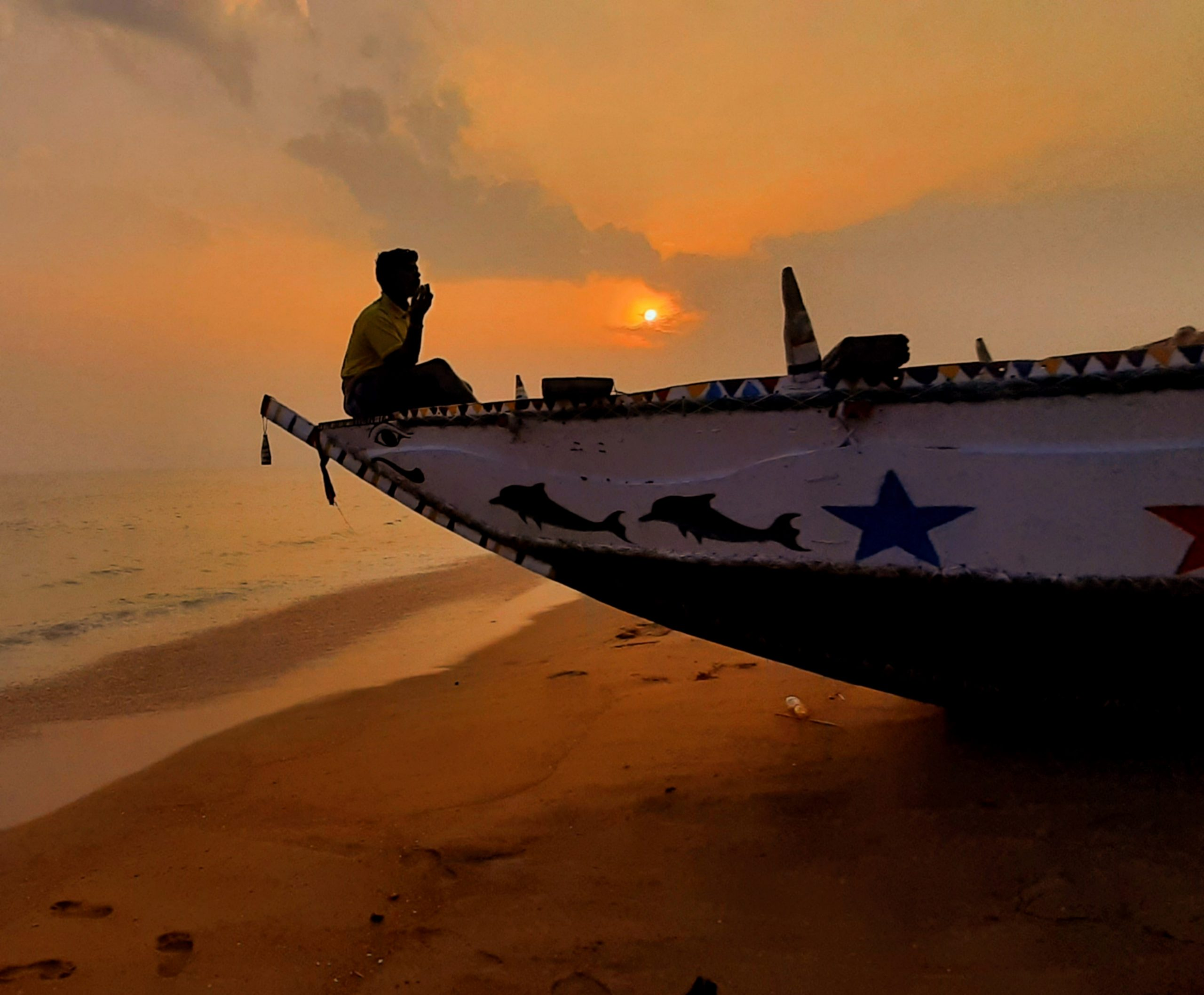 Fisherman Sitting in Boat at Sunset