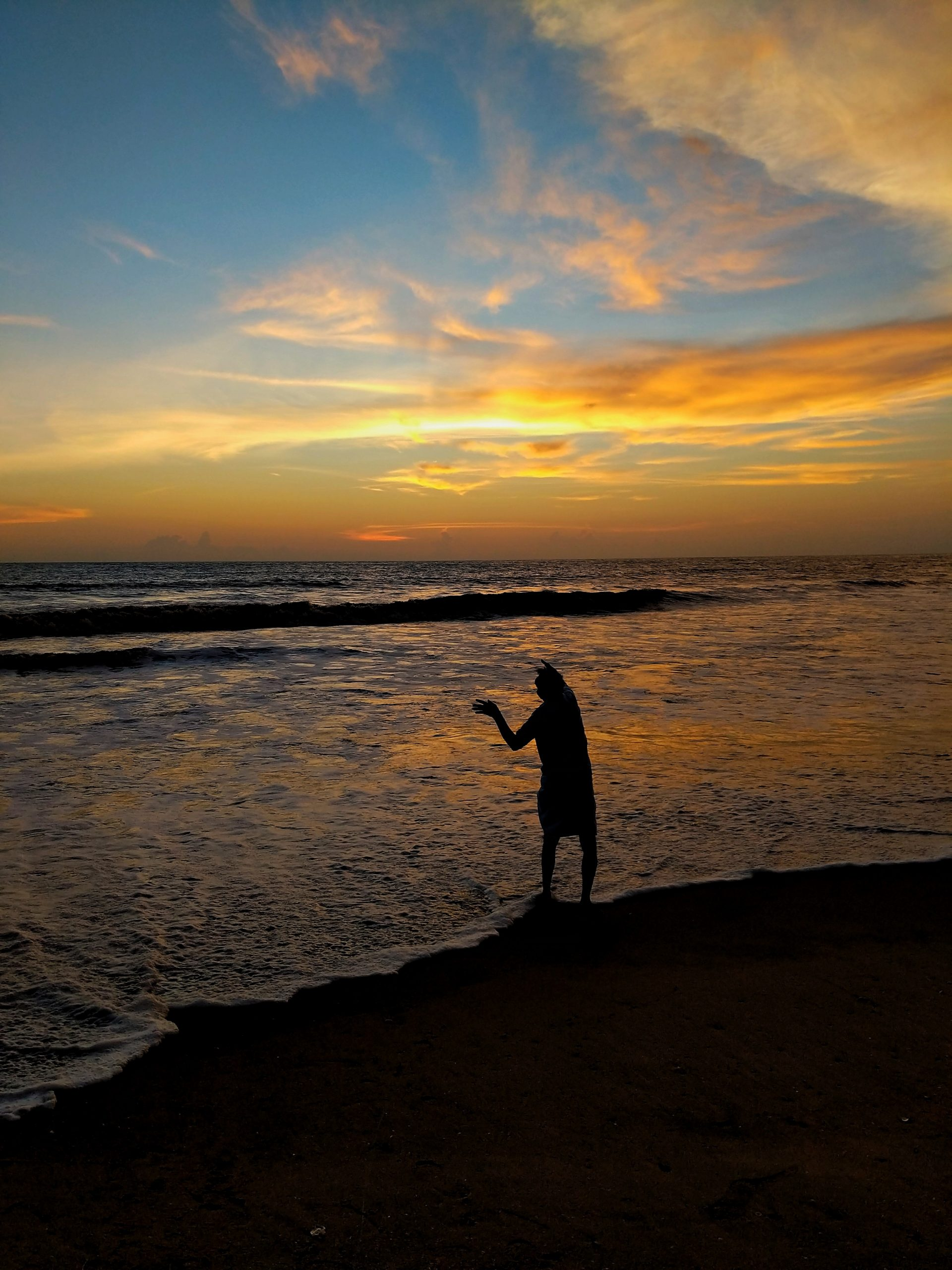 A man fishing at the time of beautiful sunset.