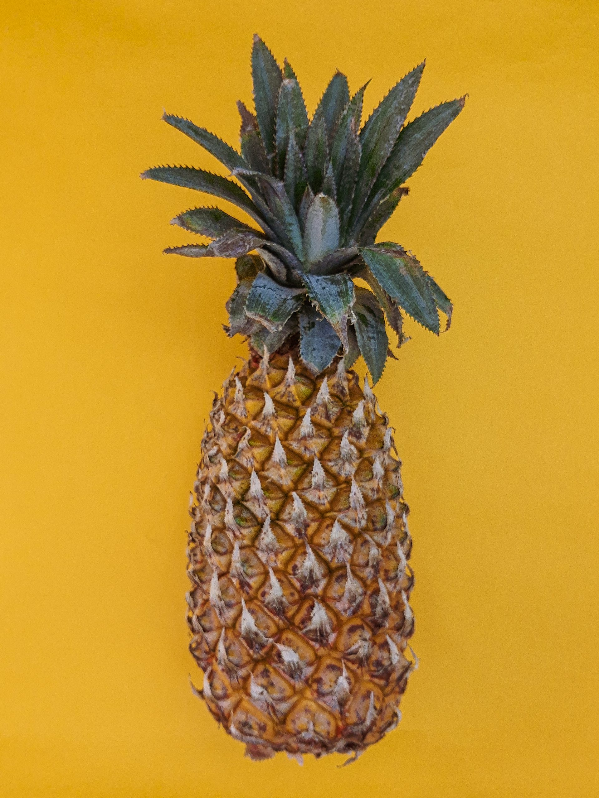 Flatlay picture of a healthy pineapple fruit