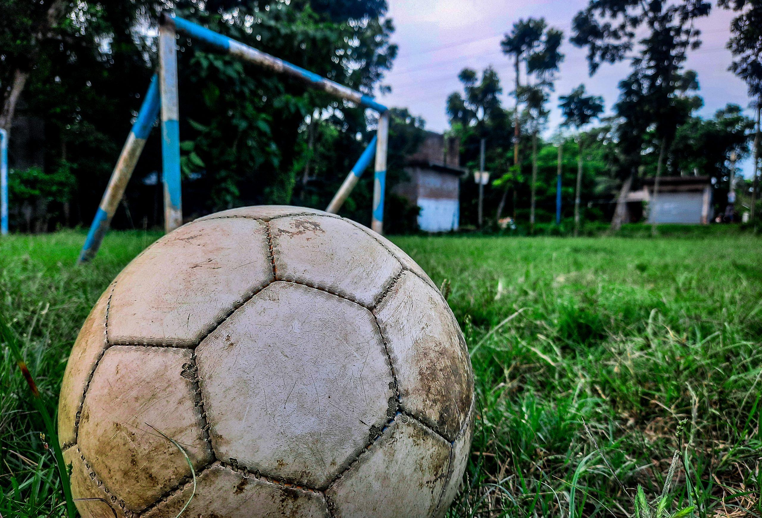 Football beside goalpost