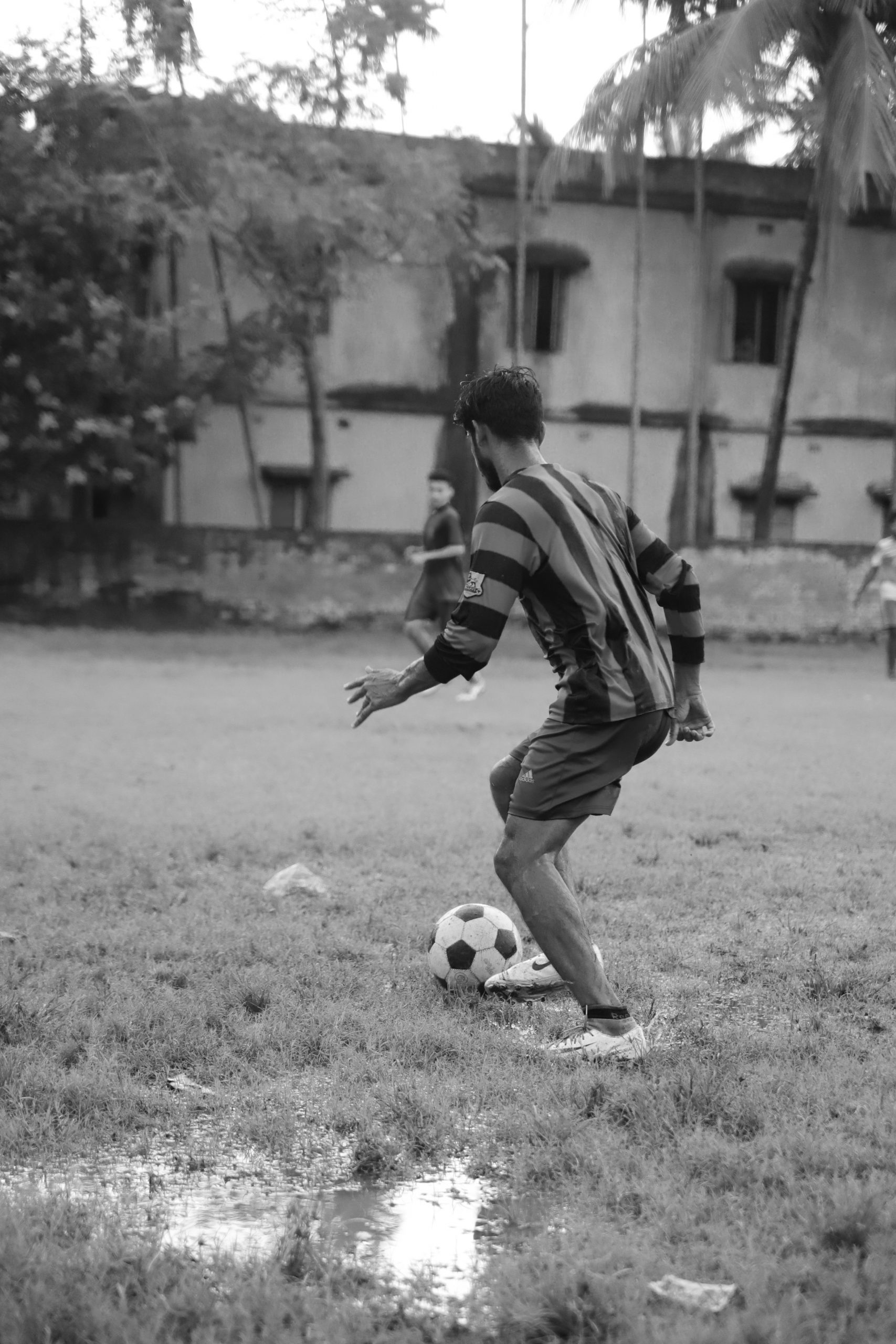 Football player about to kick the ball
