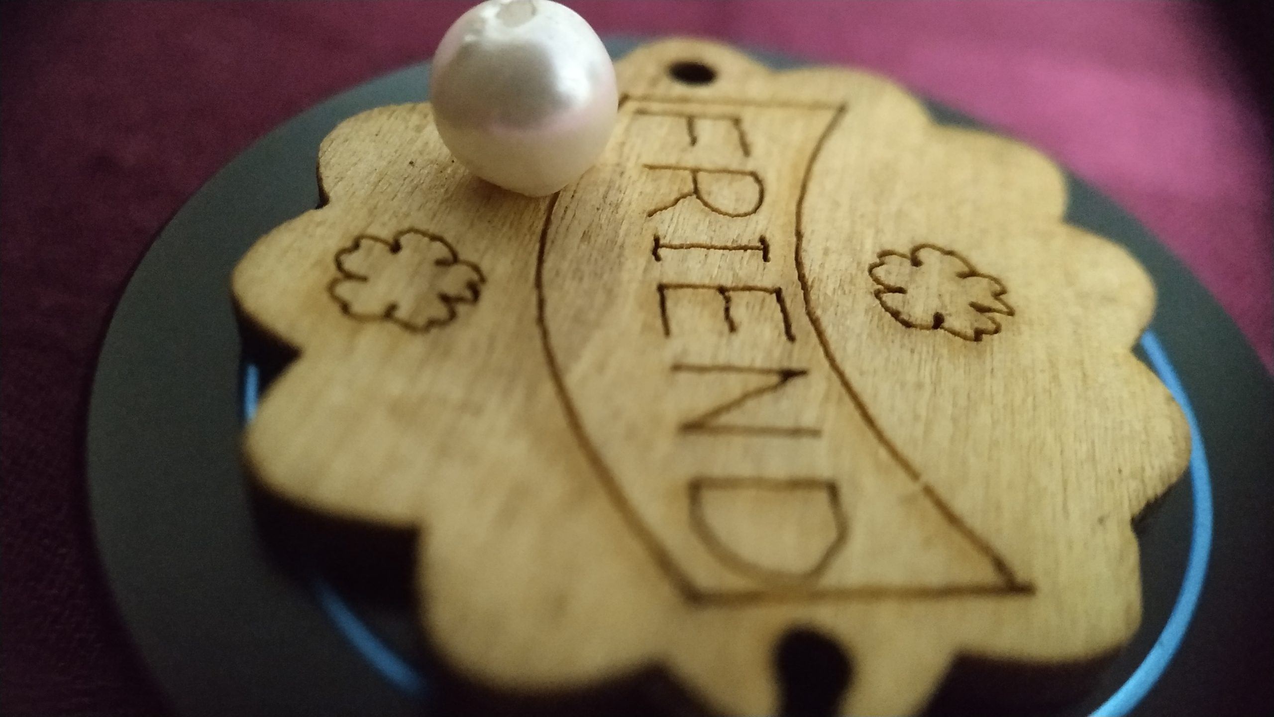 Word friend carved on a wood