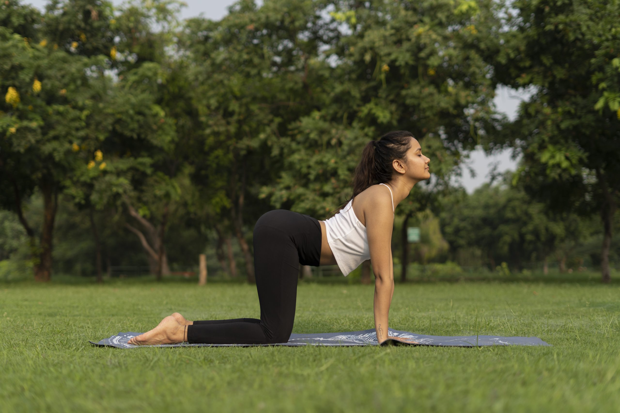 Girl Doing Cow Pose in Yoga