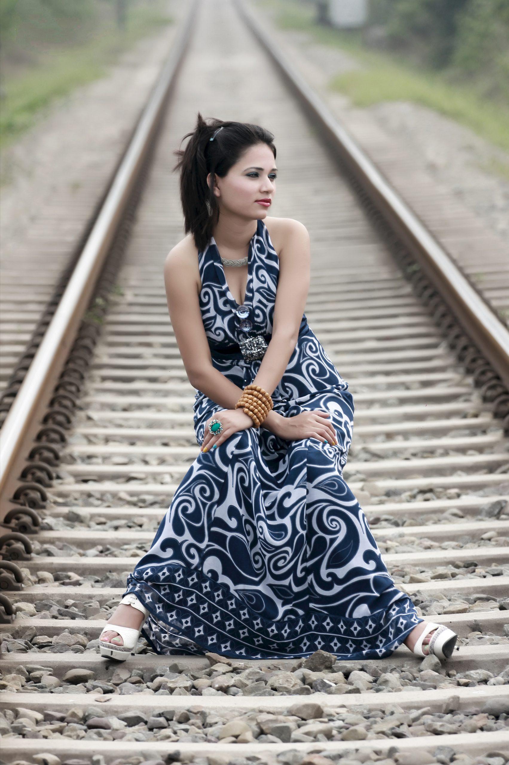 girl posing on railway track