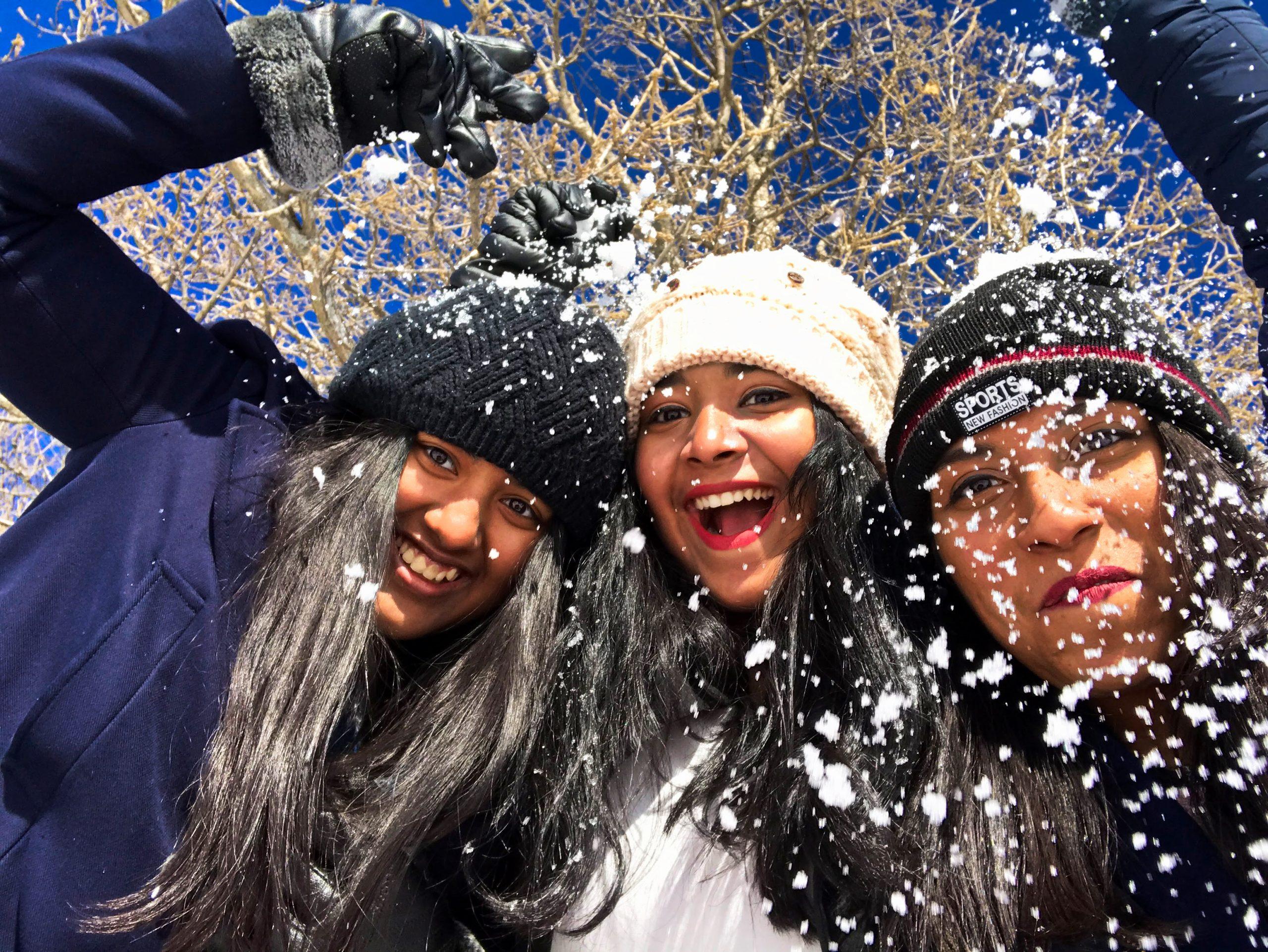 Girls enjoying snow fall