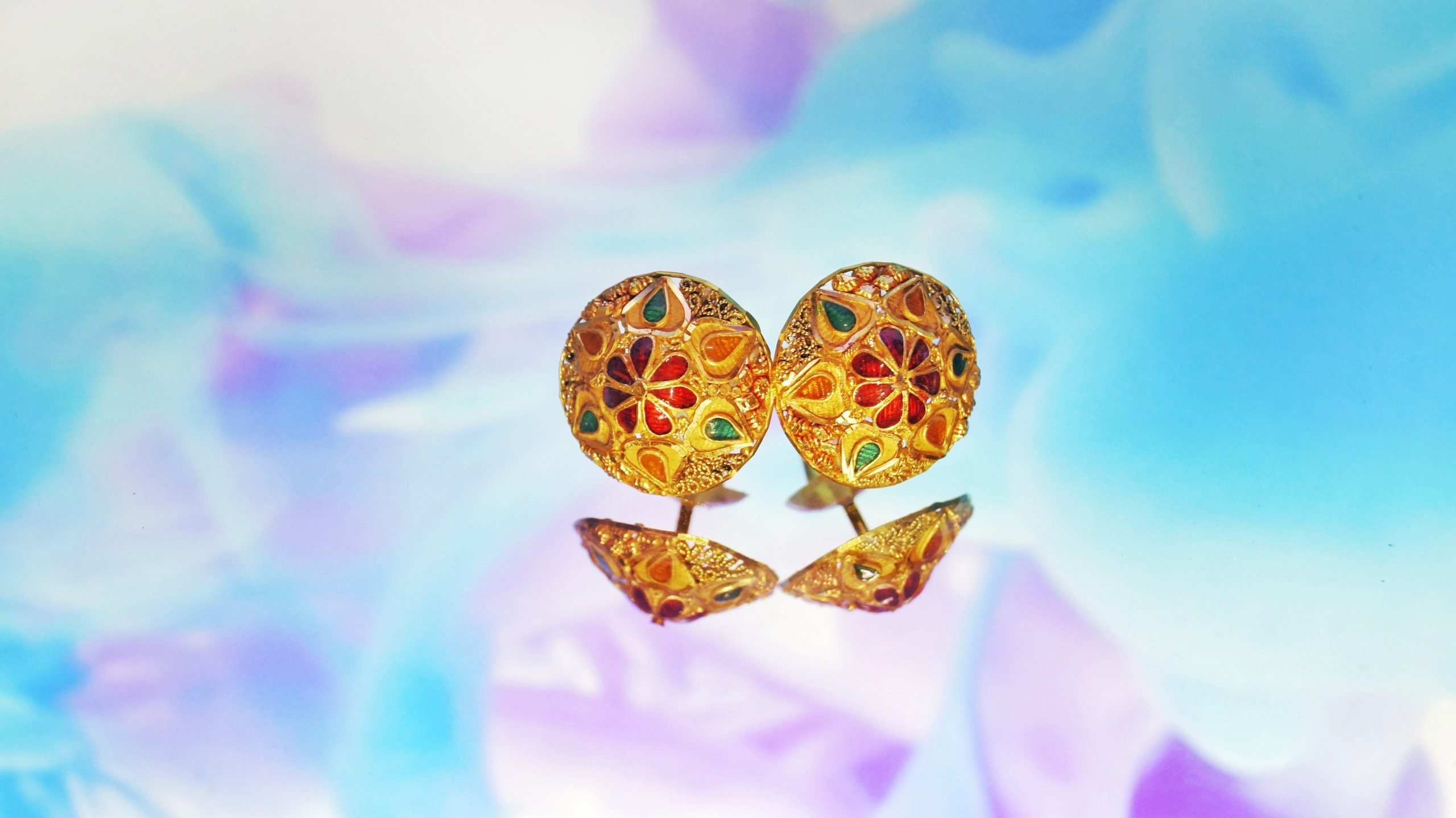 Golden earrings with colorful gemstones