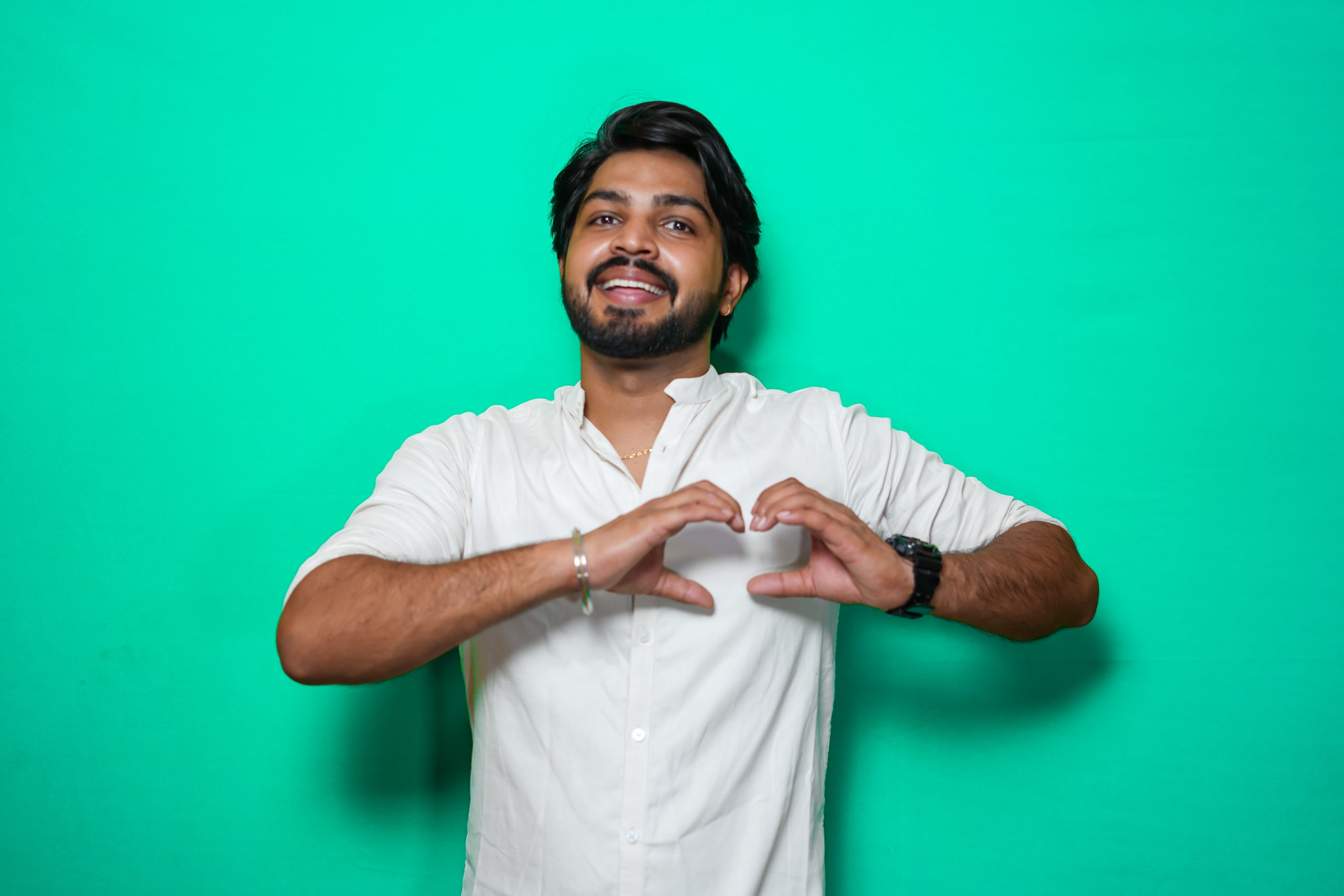 Handsome Man making Heart with hands