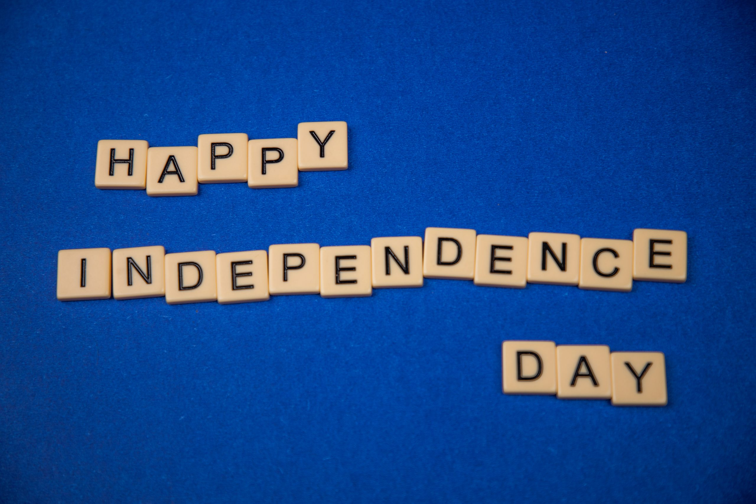 Happy independence written on scrabble