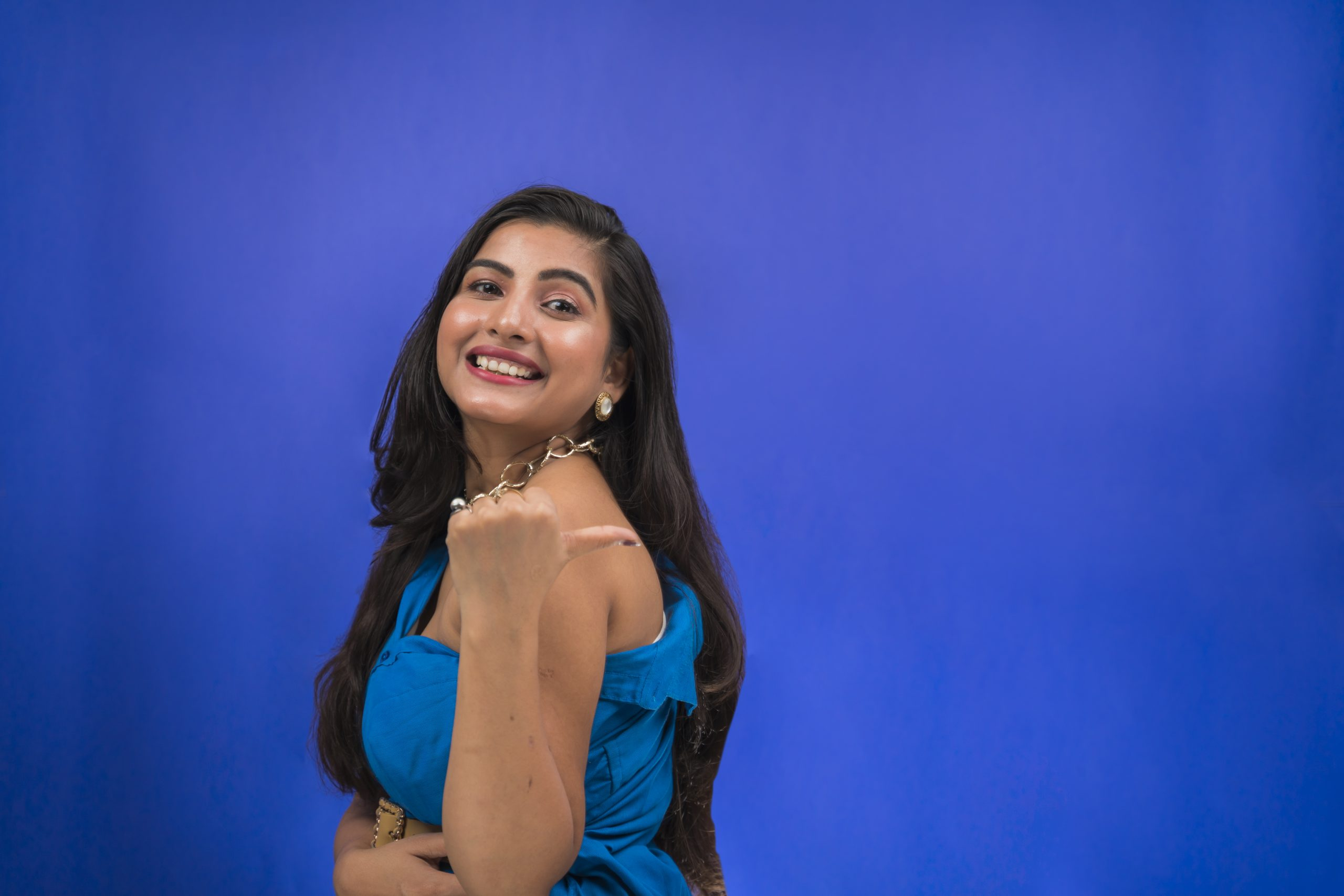 Happy indian girl pointing