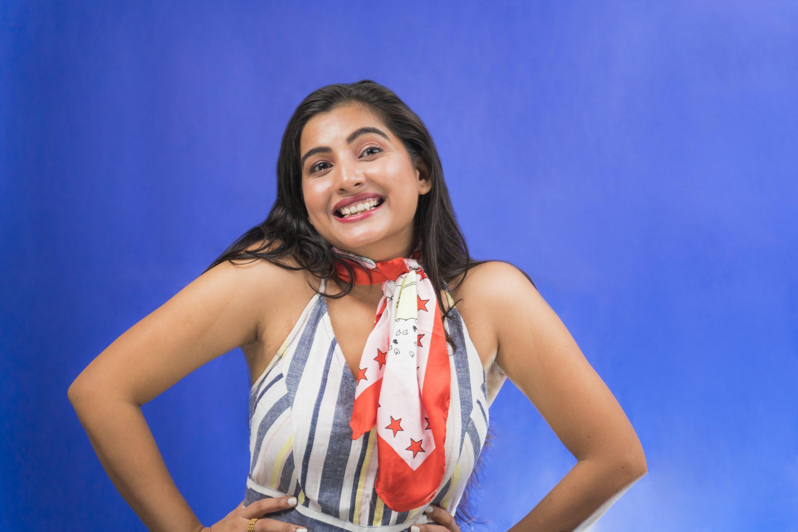 Happy indian girl shoulder shrugged