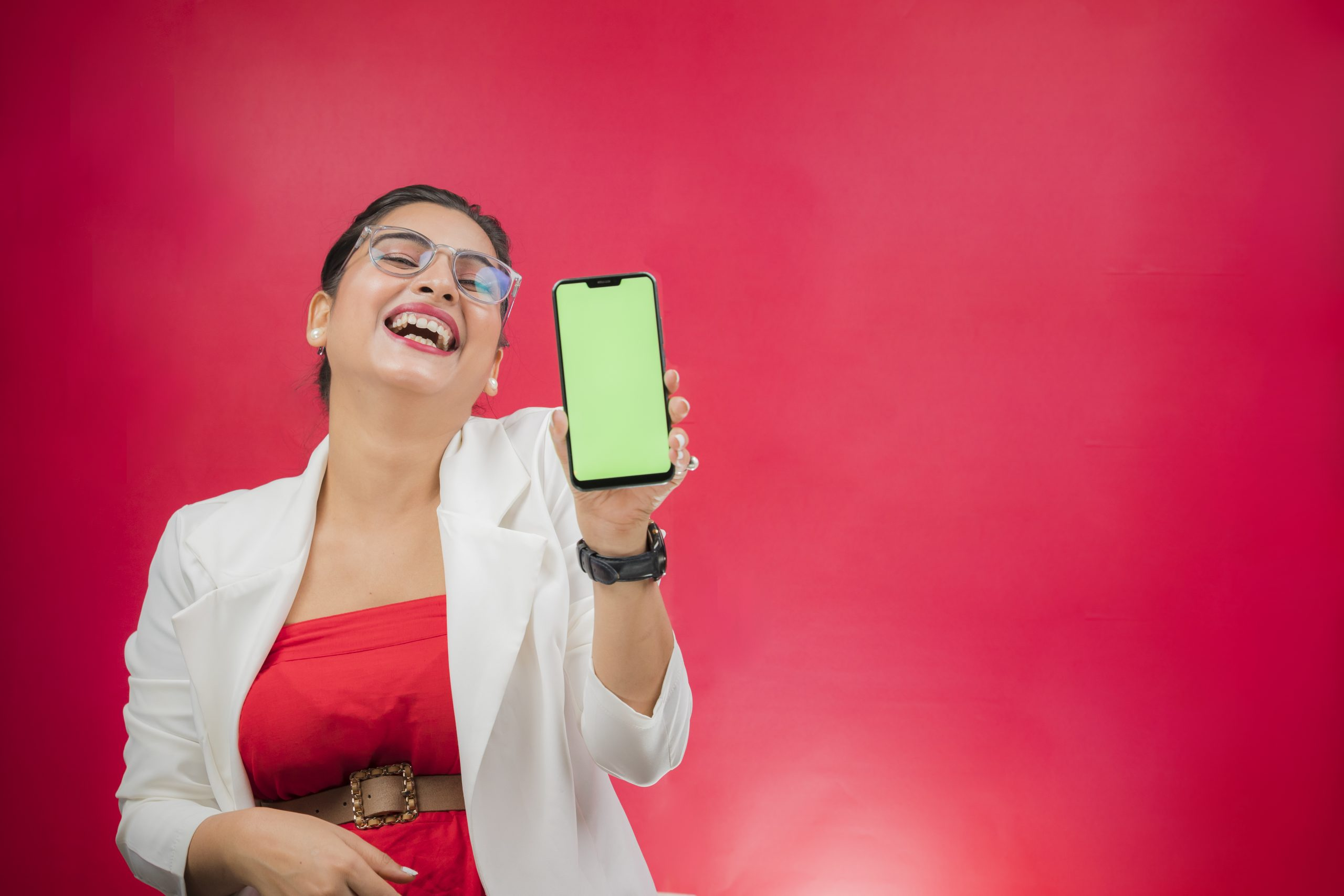 Businesswoman presenting mobile phone