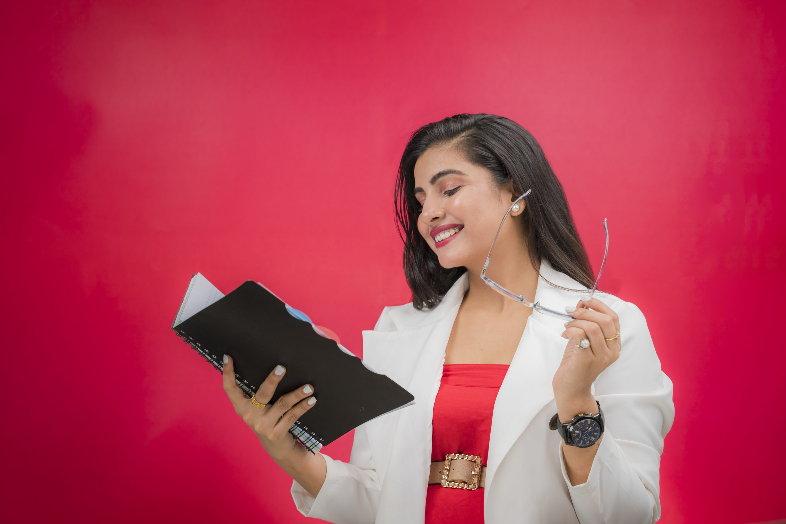 Happy working woman reading book