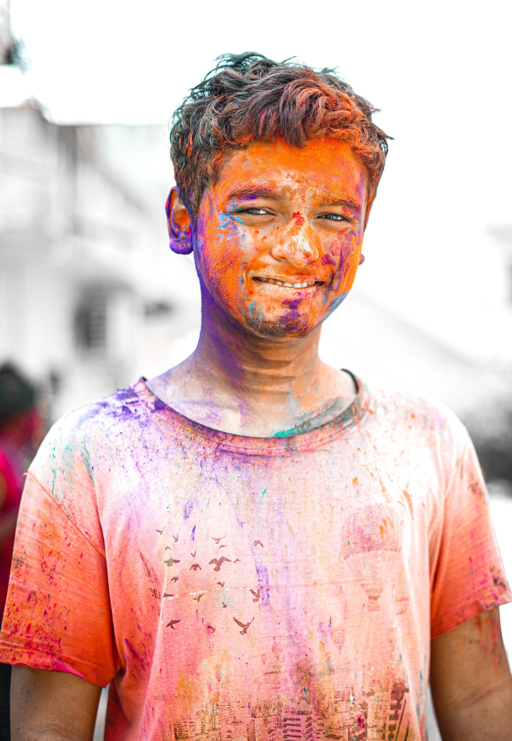 Boy covered in multicolored powder