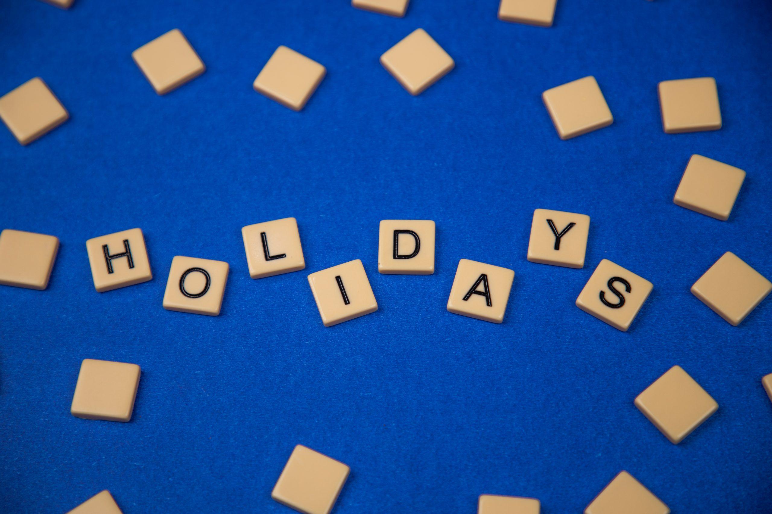 Holidays written on scrabble