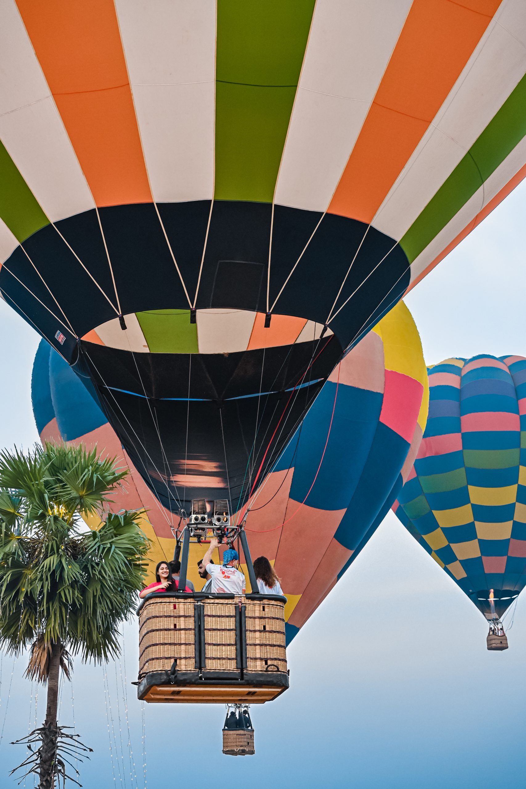 Hot- air balloons flying in sky.