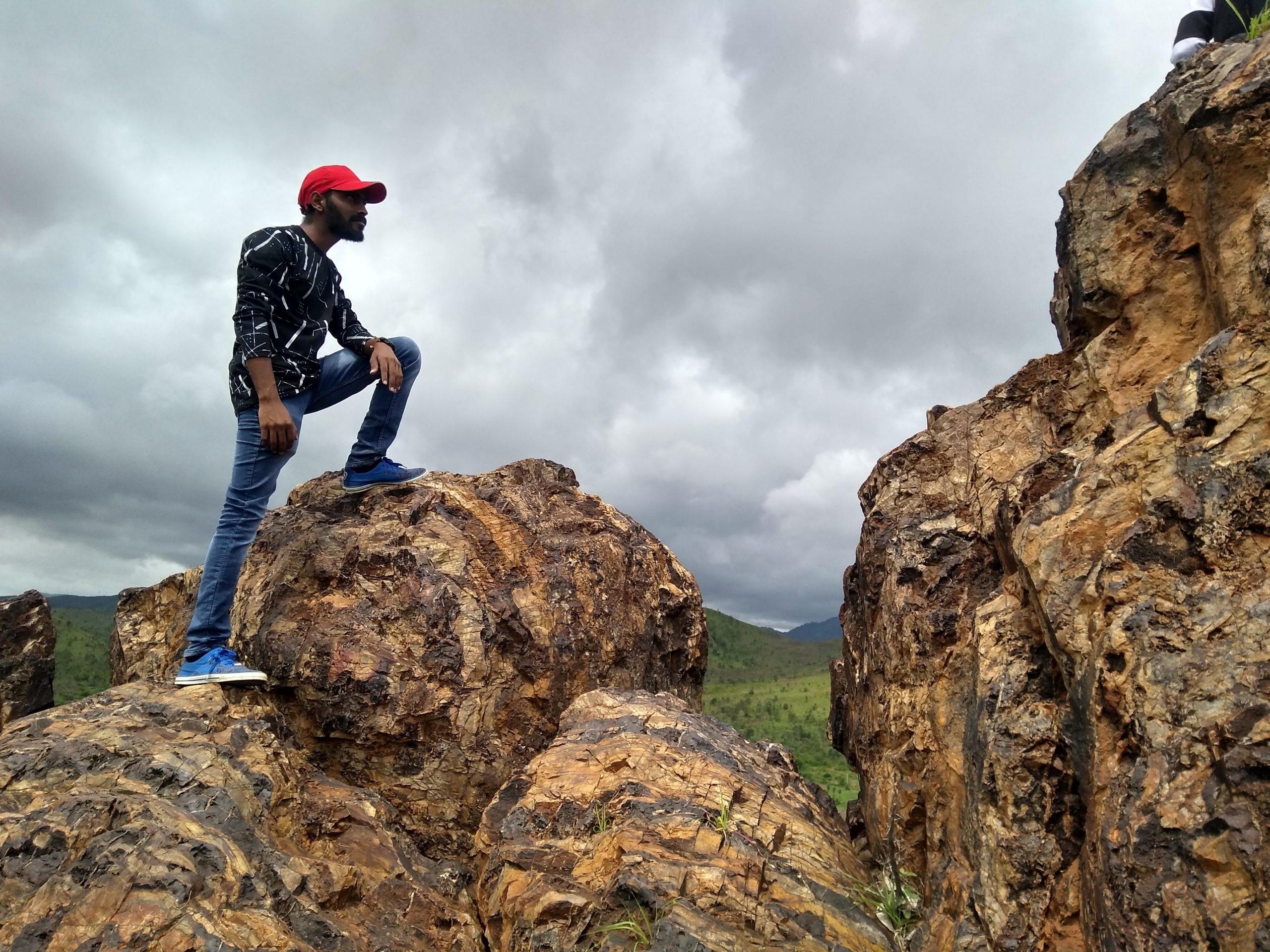 Human standing on rocks