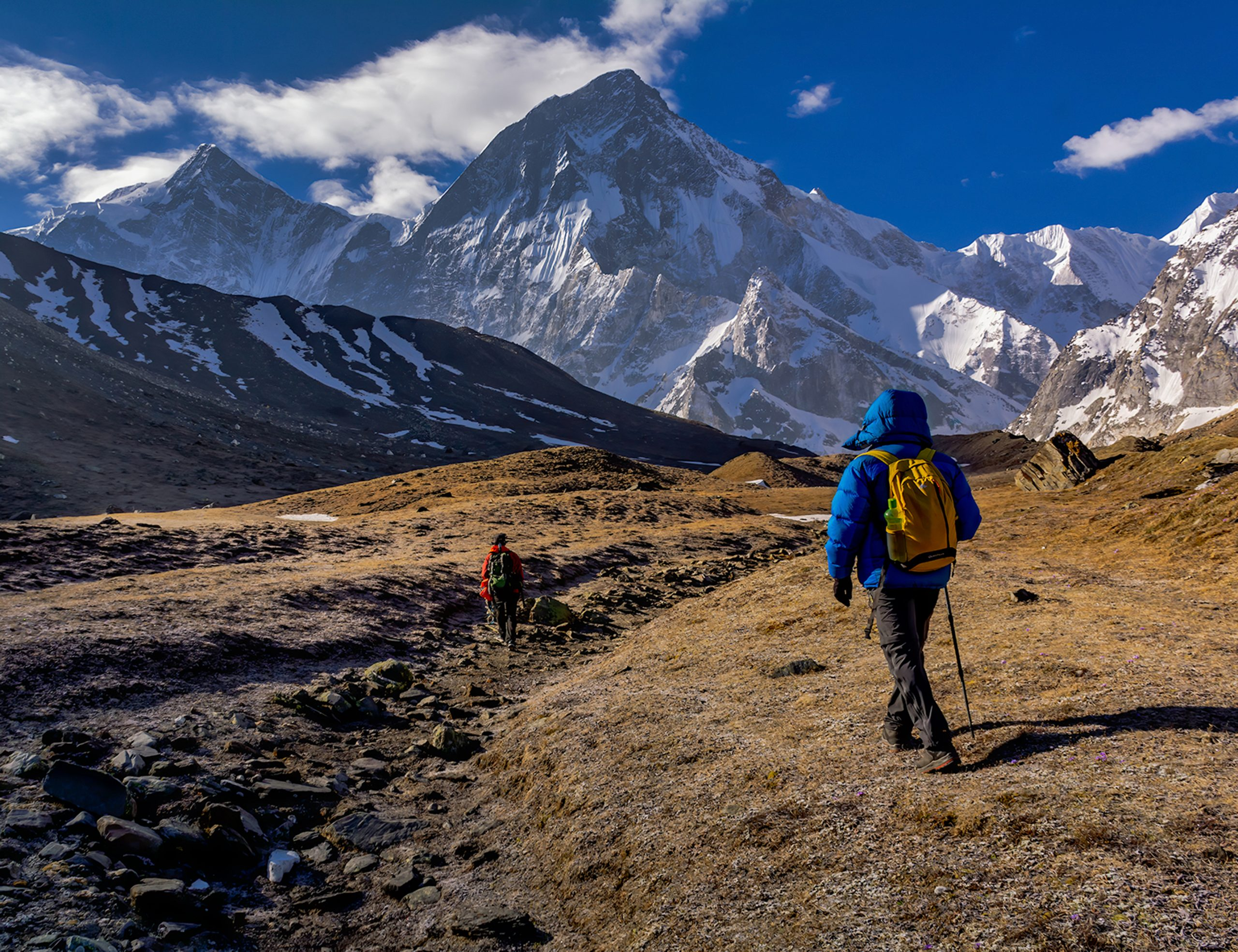 Humans trekking on a valley