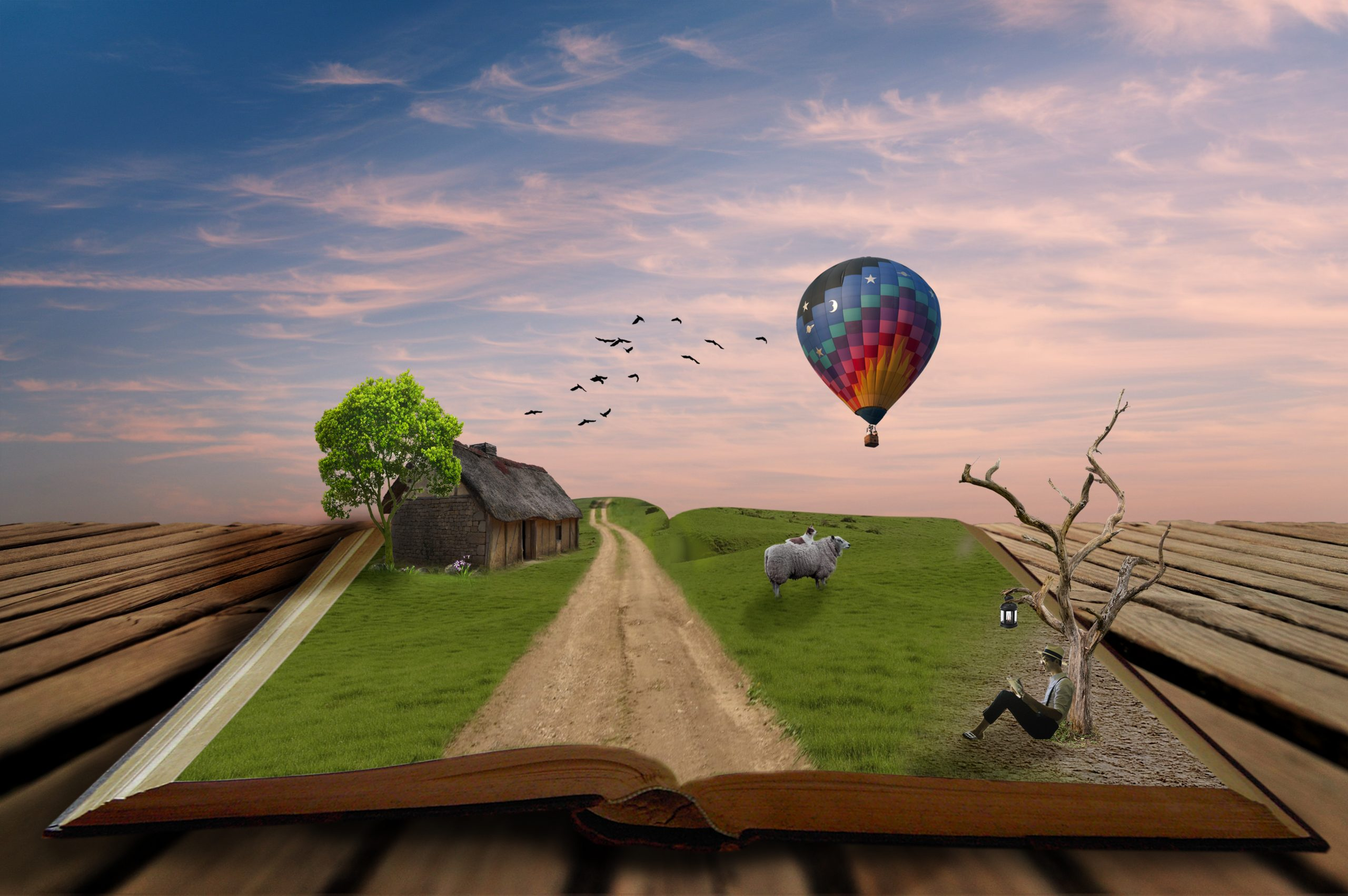 Idyllic scenery on pages of open magical book