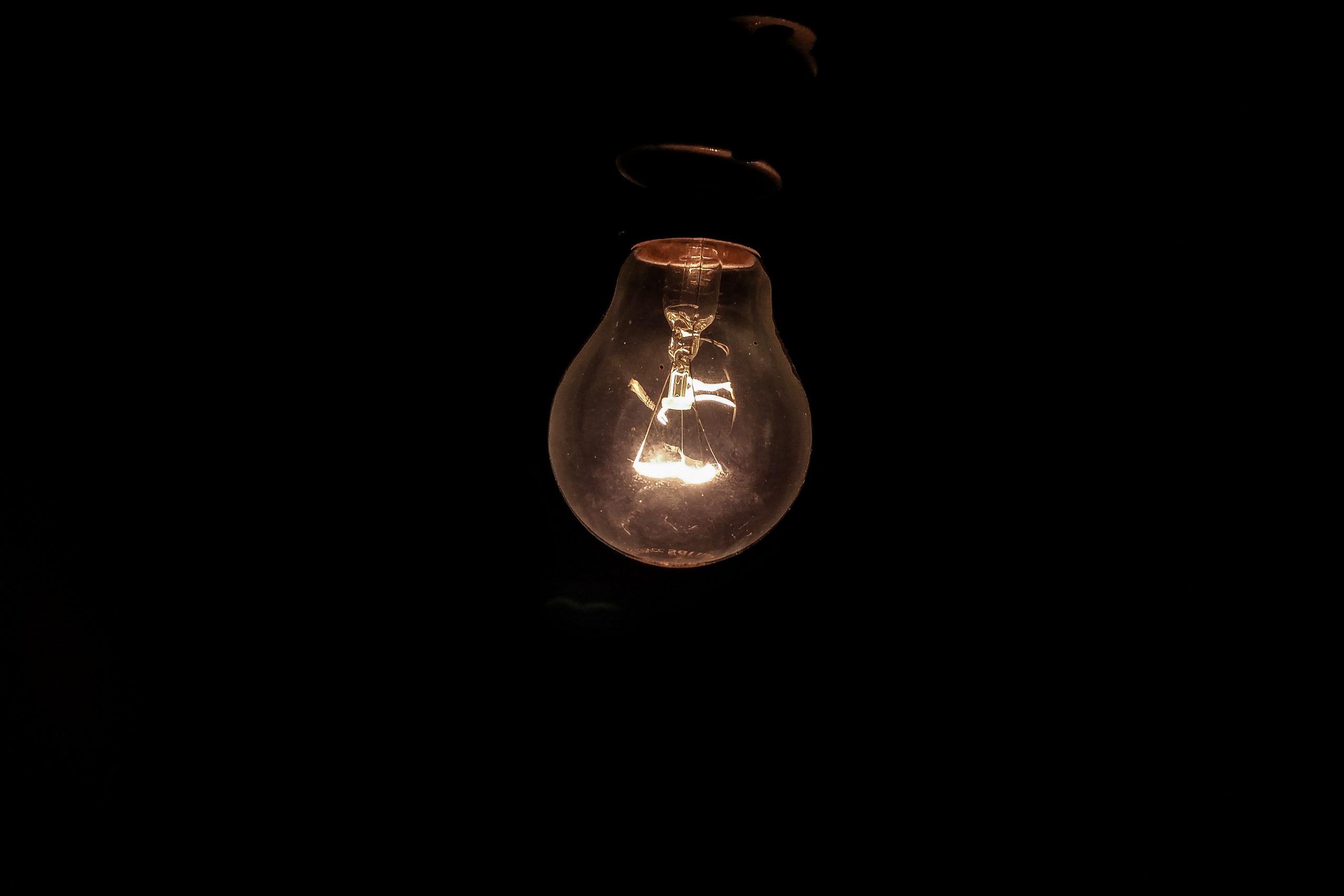 Incandescent light bulb on Dark Background