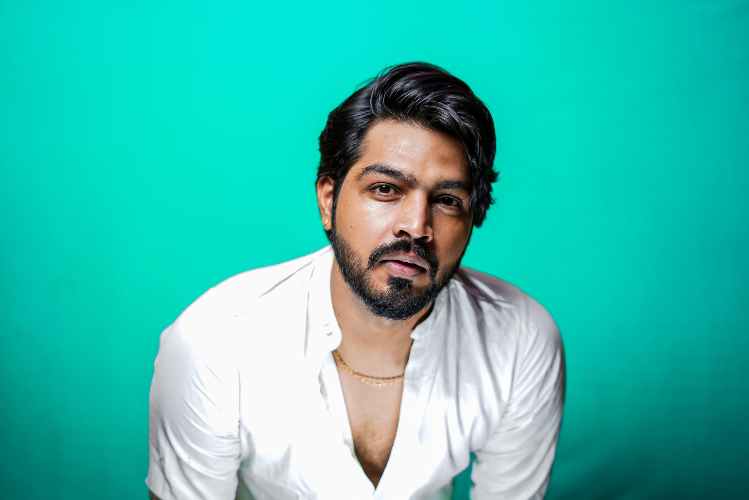 Indian Man Portrait on Green Background