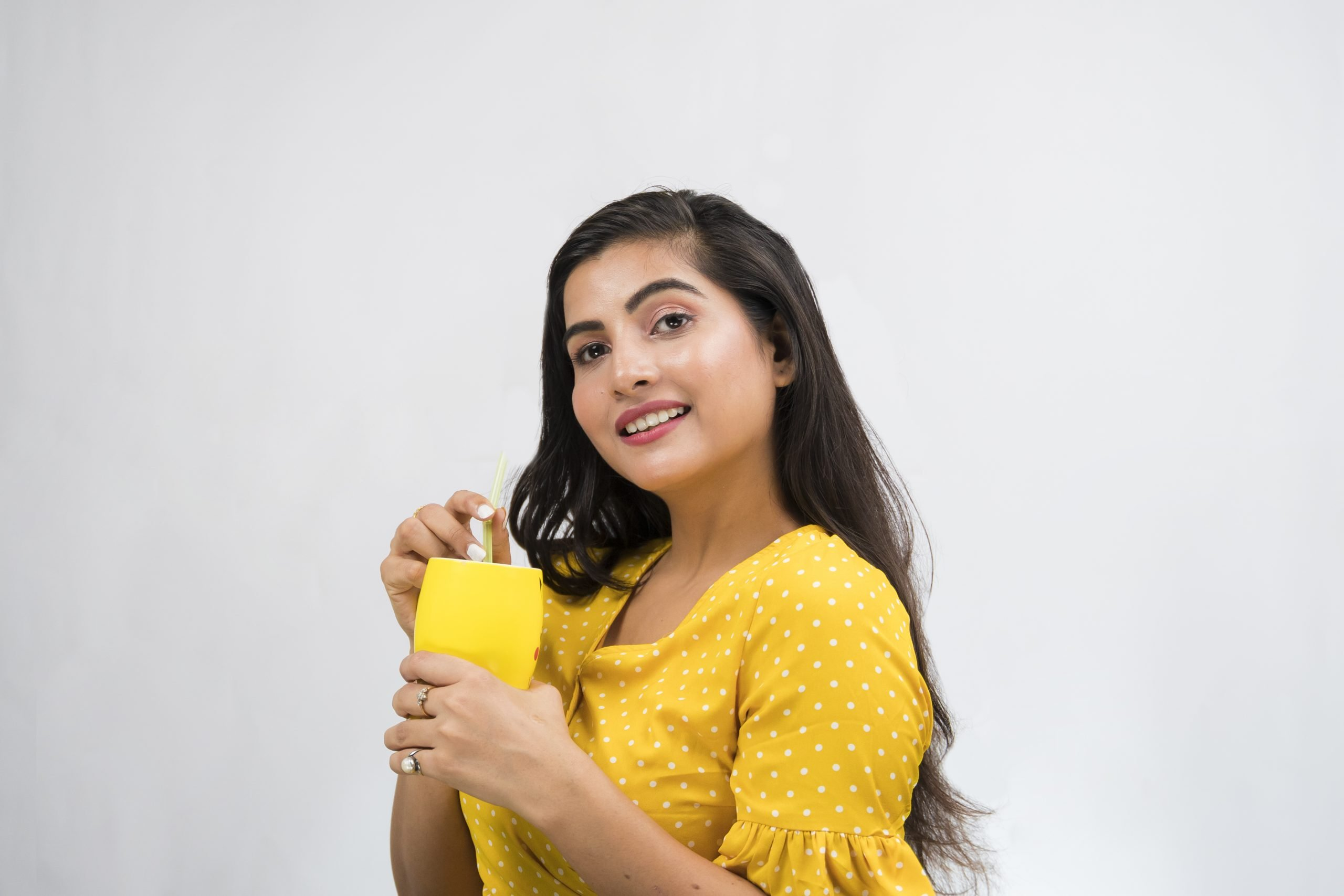 Indian girl holding a cup